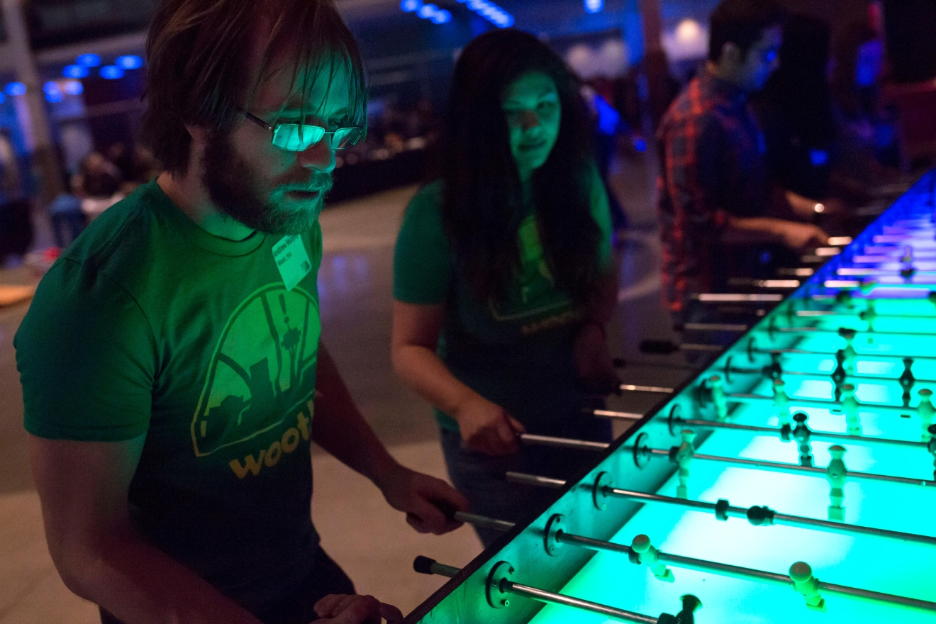 Andrew Murphy focuses on the goal during a game of foosball at the 6th annual Geekwire Bash at the CenturyLink Event Center. (Sy Bean / Seattle Refined)