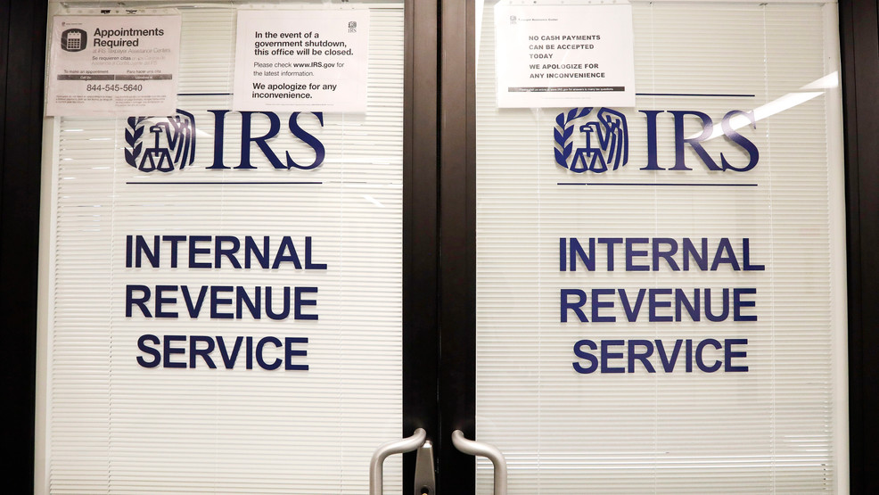 FILE - In this Jan. 16, 2019, file photo, doors at the Internal Revenue Service (IRS) in the Henry M. Jackson Federal Building are locked. (AP Photo/Elaine Thompson, File)