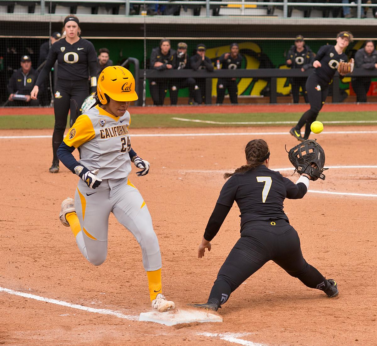 California Golden Bears Jazmyn Jackson (#24) beats the throw to Oregon Ducks first base player Mia Camuso (#7). The Ducks defeated Cal 2-1 in the second game of the three-game series Saturday. Photo by Dan Morrison, Oregon News Lab