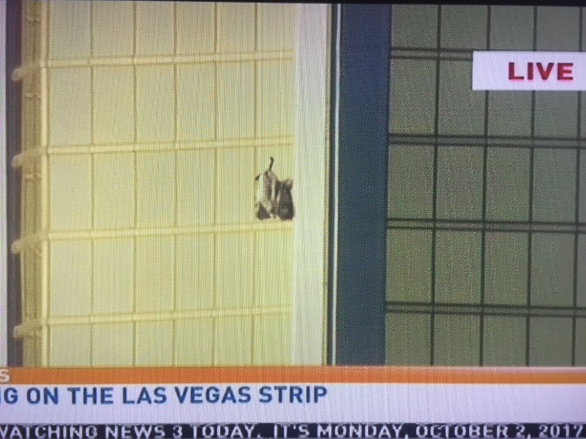 32nd floor window of room believed to be the #LasVegas shooters perch. Curtains are blowing thru the shattered glass (KSNV)