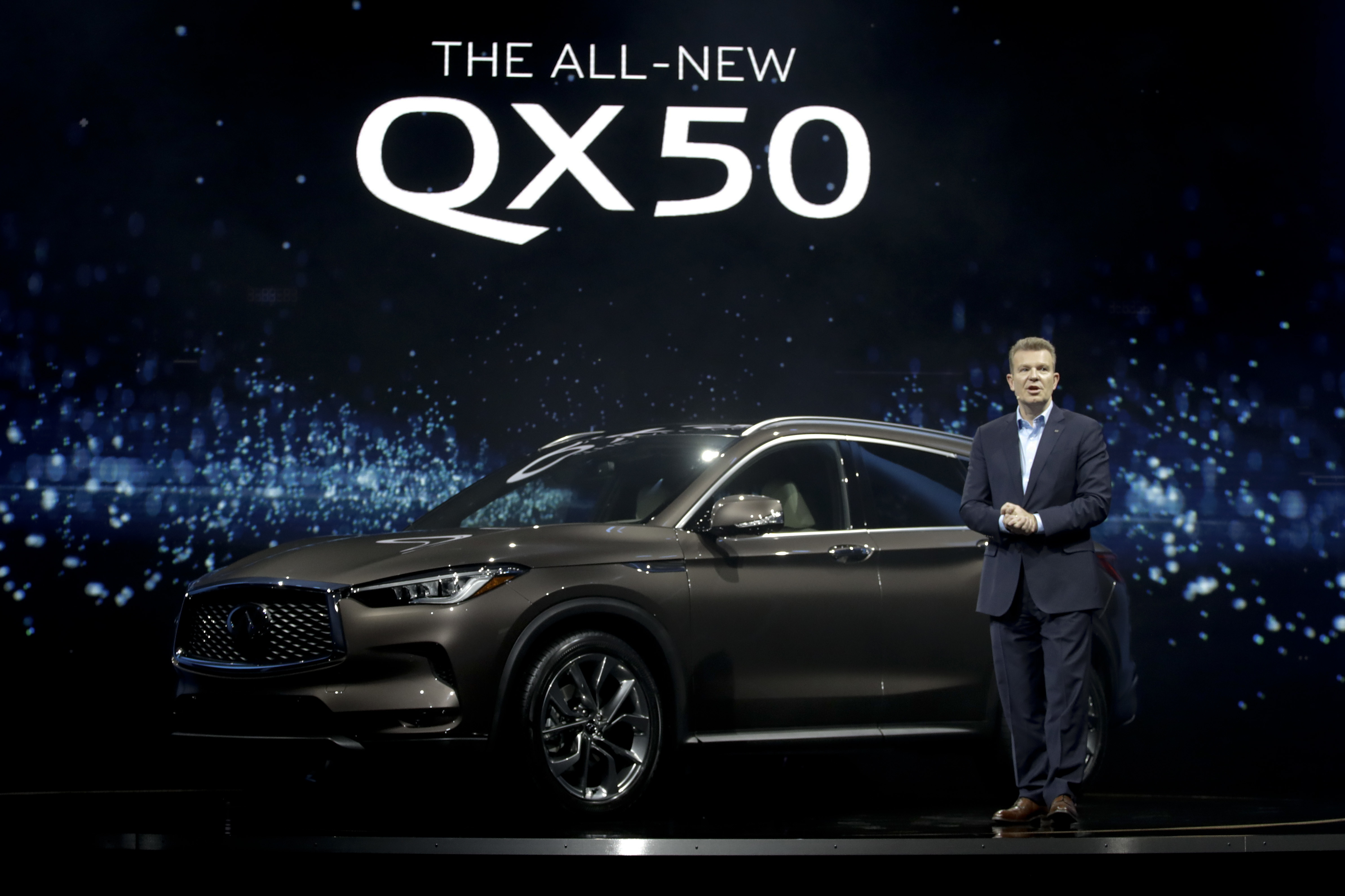 Christian Meunier, Global Division Vice President, Global Marketing and Sales Operations introduces the 2018 Infiniti QX50 as part of the AutoMobility LA auto show Tuesday, Nov. 28, 2017, in Hawthorne, Calif. (AP Photo/Chris Carlson)