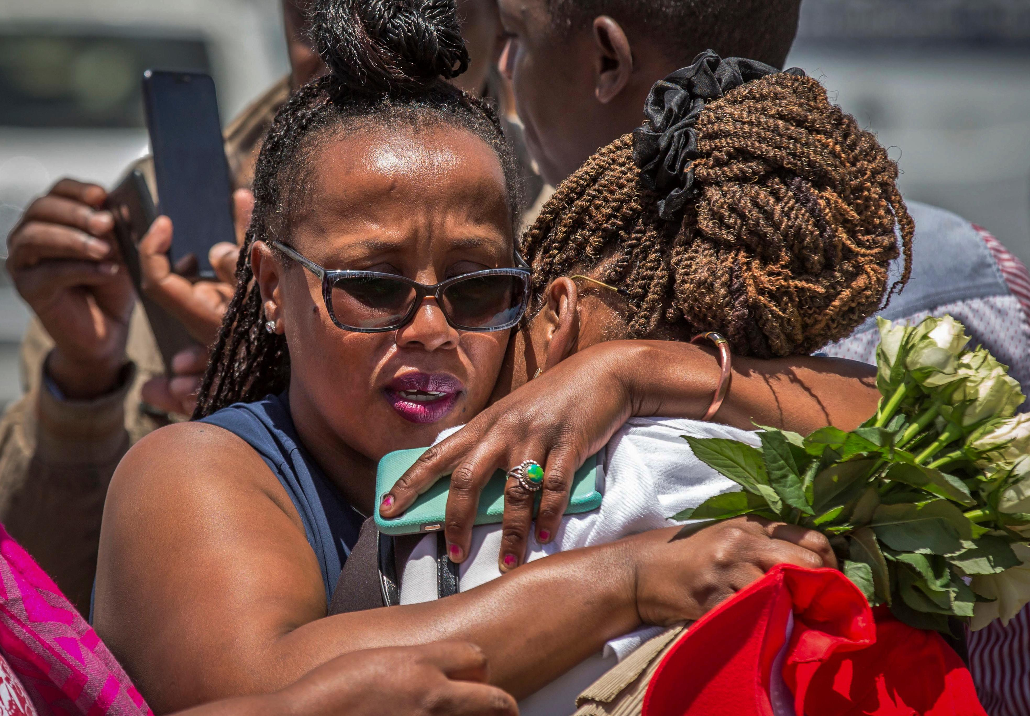 Relatives of a crash victim mourn at the scene where the Ethiopian Airlines Boeing 737 Max 8 crashed shortly after takeoff on Sunday killing all 157 on board, near Bishoftu, south-east of Addis Ababa, in Ethiopia, Friday, March 15. (AP Photo/Mulugeta Ayene)