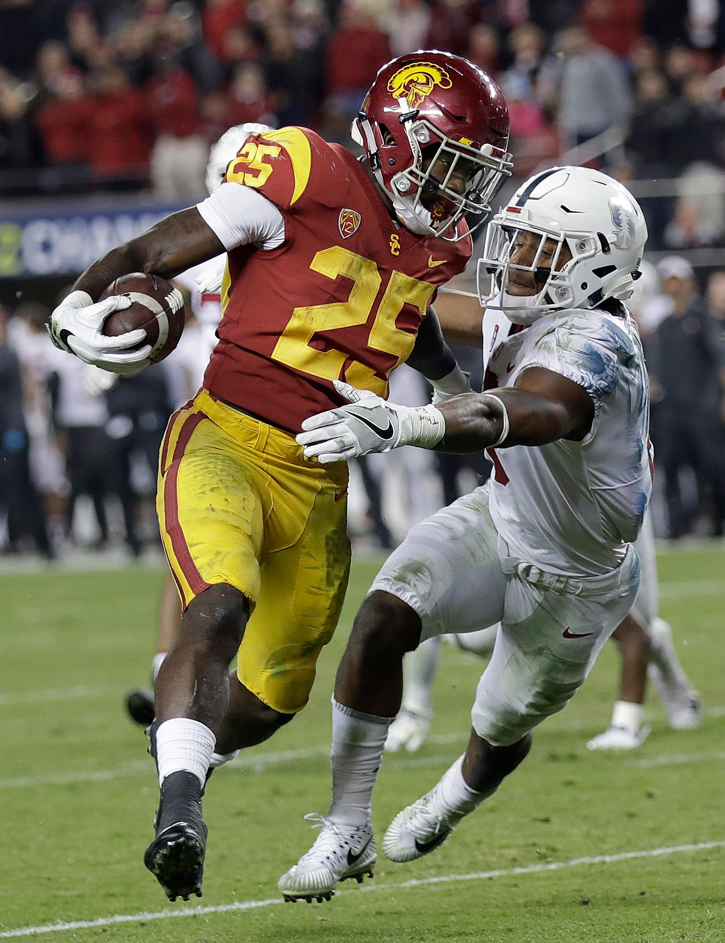 Southern California running back Ronald Jones II (25) runs past Stanford safety Justin Reid to score a touchdown during the second half of the Pac-12 Conference championship NCAA college football game in Santa Clara, Calif., Friday, Dec. 1, 2017. (AP Photo/Marcio Jose Sanchez)