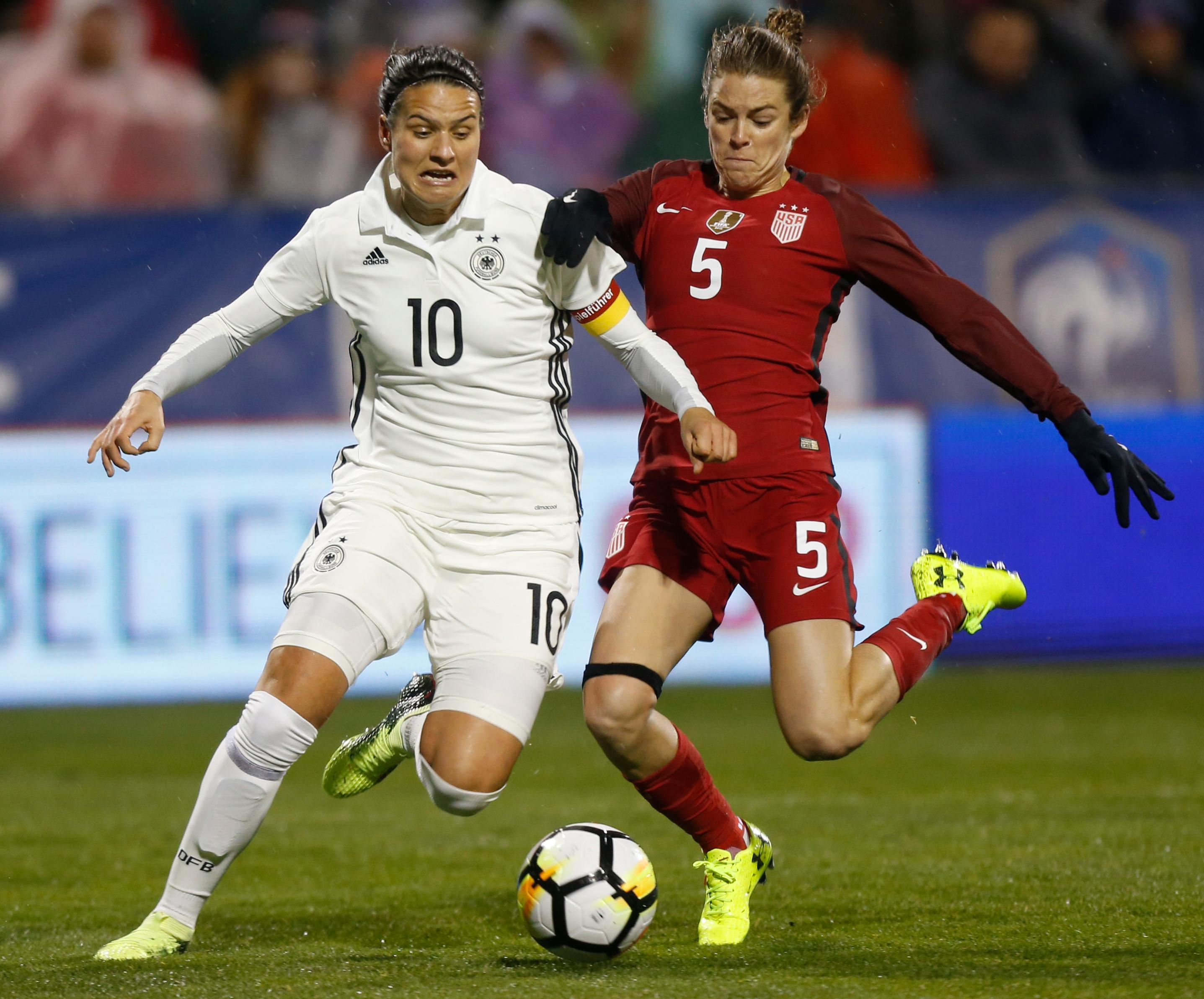 Germany's Dzsenifer Marozsan, left, and United States' Kelley O'Hara vie for the ball during the first half of a SheBelieves Cup women's soccer match Thursday, March 1, 2018, in Columbus, Ohio. (AP Photo/Jay LaPrete)