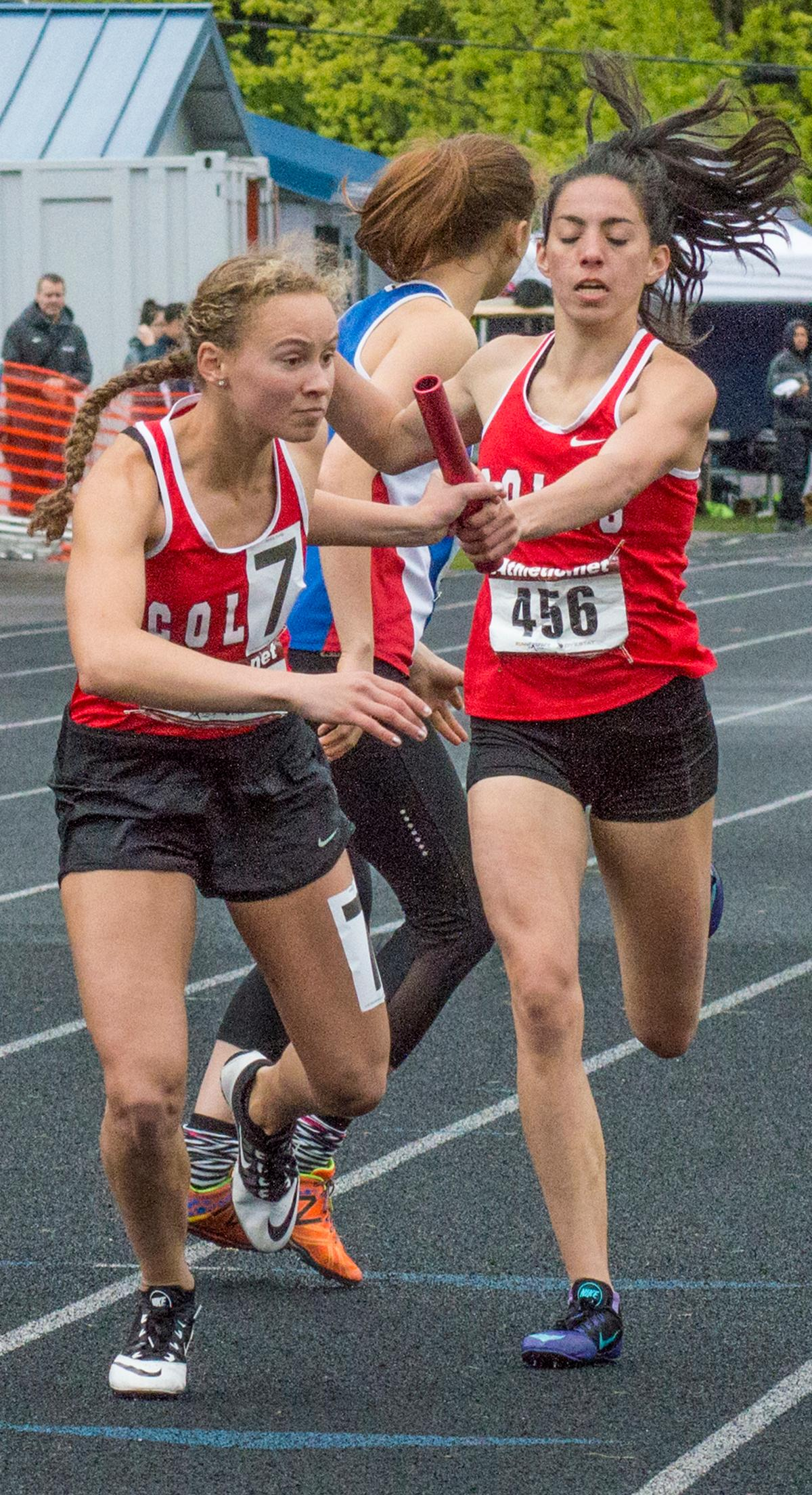 Thurston's Rhianna Brown passes the baton to anchor Tara Crosswhite in the Women's 4 x 400m event at the 5A-3 Midwestern League District Championship. The Colts take first with a time of 4:10.75. Photo by Emily Gonzalez, Oregon News Lab.