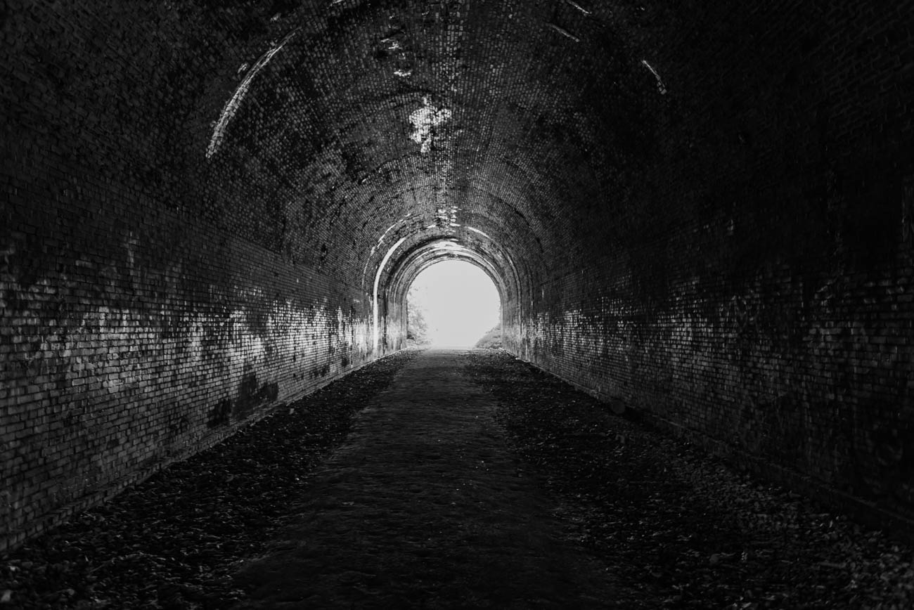 The Moonville Tunnel is easily the most recognizable landmark along the trail. And it's made entirely of masonry that bends into an arch. There were lots of train accidents at this site subsequently establishing itself as a haunted place. / Image: Mike Menke // Published: 7.8.18