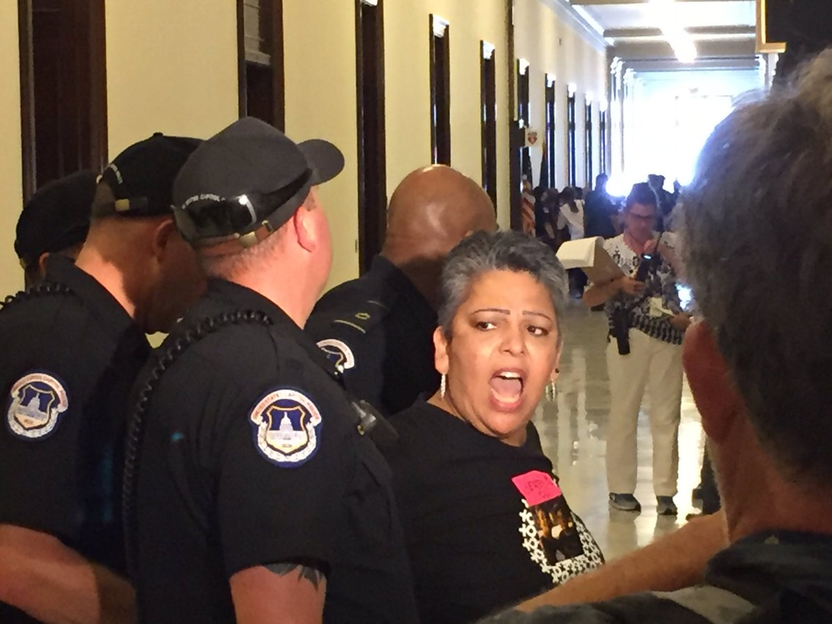 Capitol Police officers drag away protestors inside Senate office buildings in Washington on July 19, 2017. (Photo: Sinclair Broadcast Group)