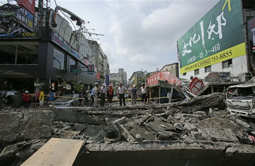 Locals survey the damage from massive gas explosions in Kaohsiung, Taiwan.