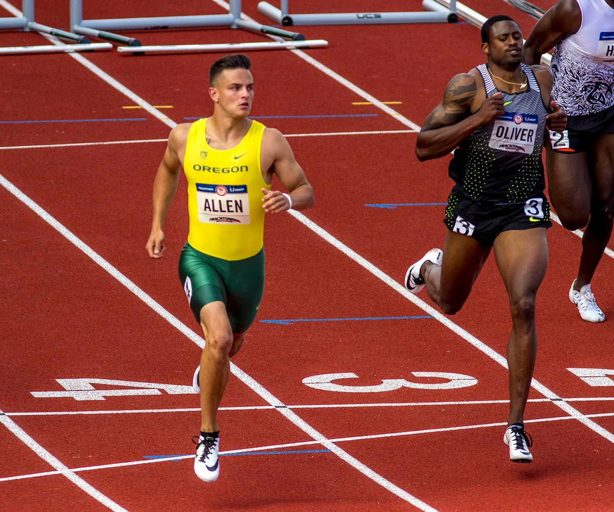Oregon�s Devon Allen, left, and Nike�s David Oliver, right, cross the finish line of the Men�s 110m Hurdles semi-finals. Allen finished the race with a time of 13.40 and Oliver finished with a time of 13.46. Allen went on to win in the finals. Day nine of the U.S. Olympic Track and Field Trials took place Saturday at Hayward Field in Eugene, Ore. Events continue through July 10. (Photo by Amanda Butt)