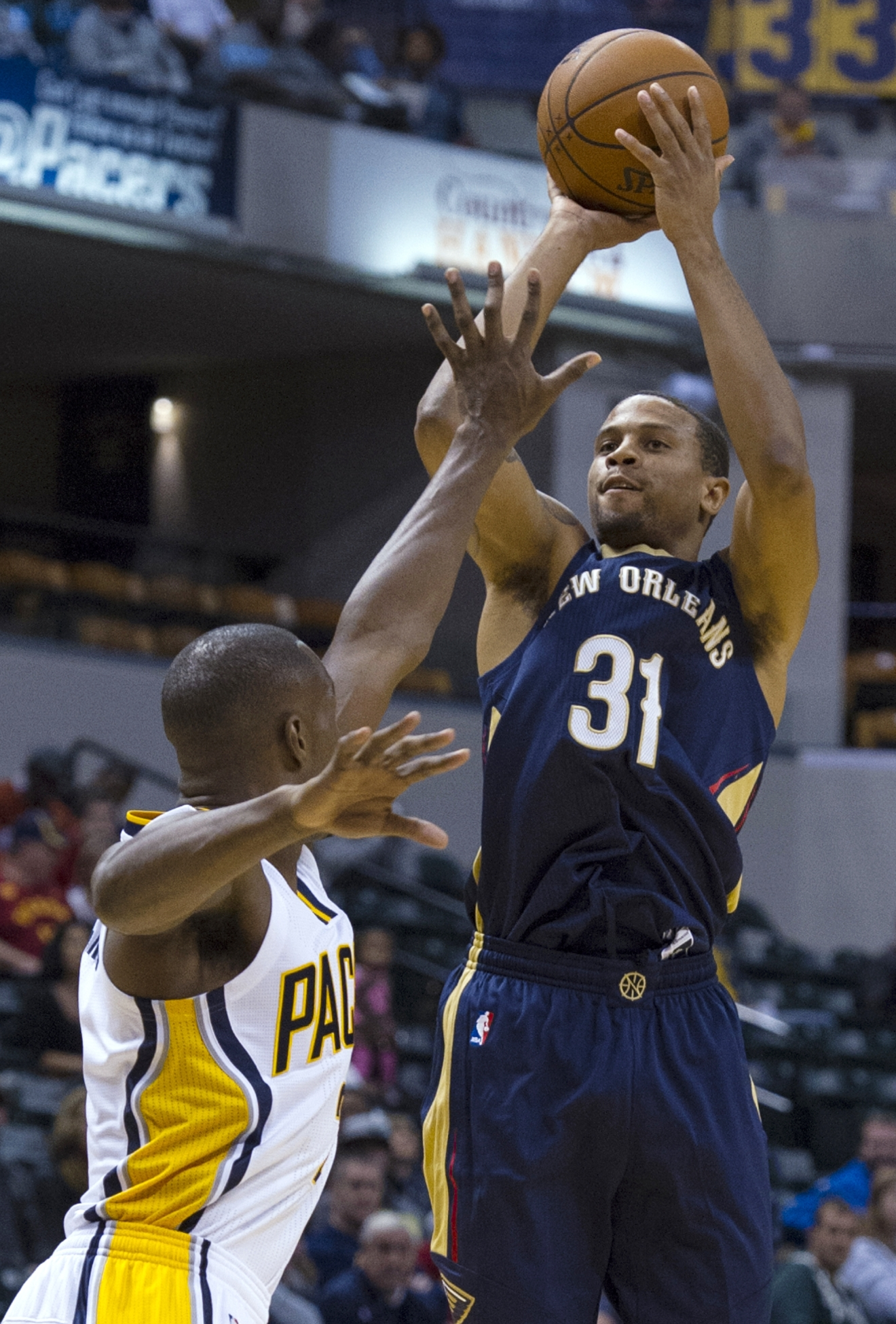 FILE - In this Oct. 3, 2015, file photo, New Orleans Pelicans' Bryce Dejean-Jones (31) shoots during the first half of a preseason NBA basketball game against the Indiana Pacers in Indianapolis.  Police say Saturday, May 28, 2016,  Dejean-Jones was fatally shot after breaking down the door to a Dallas apartment. Sr. Cpl. DeMarquis Black said in a statement that officers were called early Saturday morning and found the 23-year-old player collapsed in an outdoor passageway. He was taken to a hospital where he died. (AP Photo/Doug McSchooler, File)