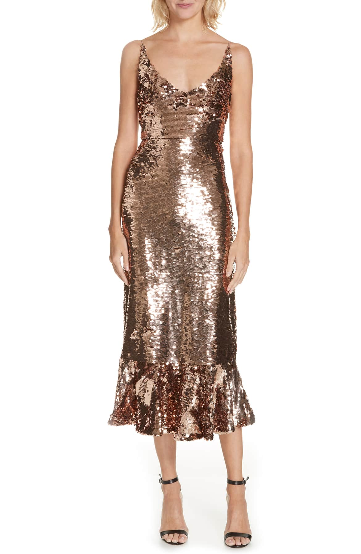 <p>Shimmering bronze sequins sweep across a curve-hugging midi that releases into a twirly ruffled hem for mesmerizing movement all night long. $795. (Image: Nordstrom){&amp;nbsp;}</p><p></p>