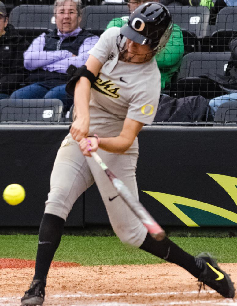 Oregon Ducks Haley Cruse (#26) swings and misses the first pitch resulting in a strike. The Ducks are now 35-0 this season matching a NCAA record for most consecutive wins to start a season, winning the first game 3-1 then following up with a 8-0 win in the second and will next play UCLA on April 7th in Los Angeles, California. Photo by Jonathan Booker, Oregon News Lab