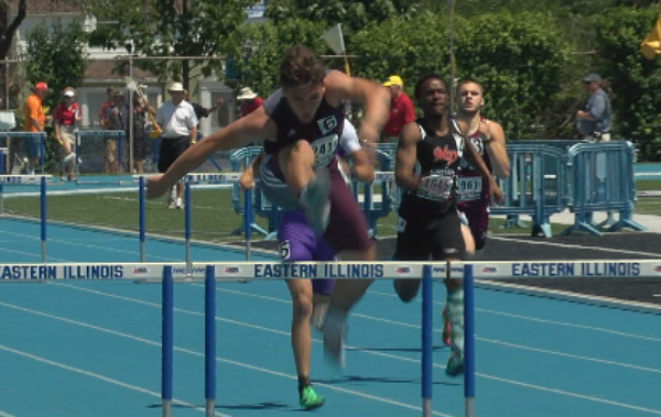 Unity's Steven Migut runs the fastest time of the day in the 300 meter hurdles