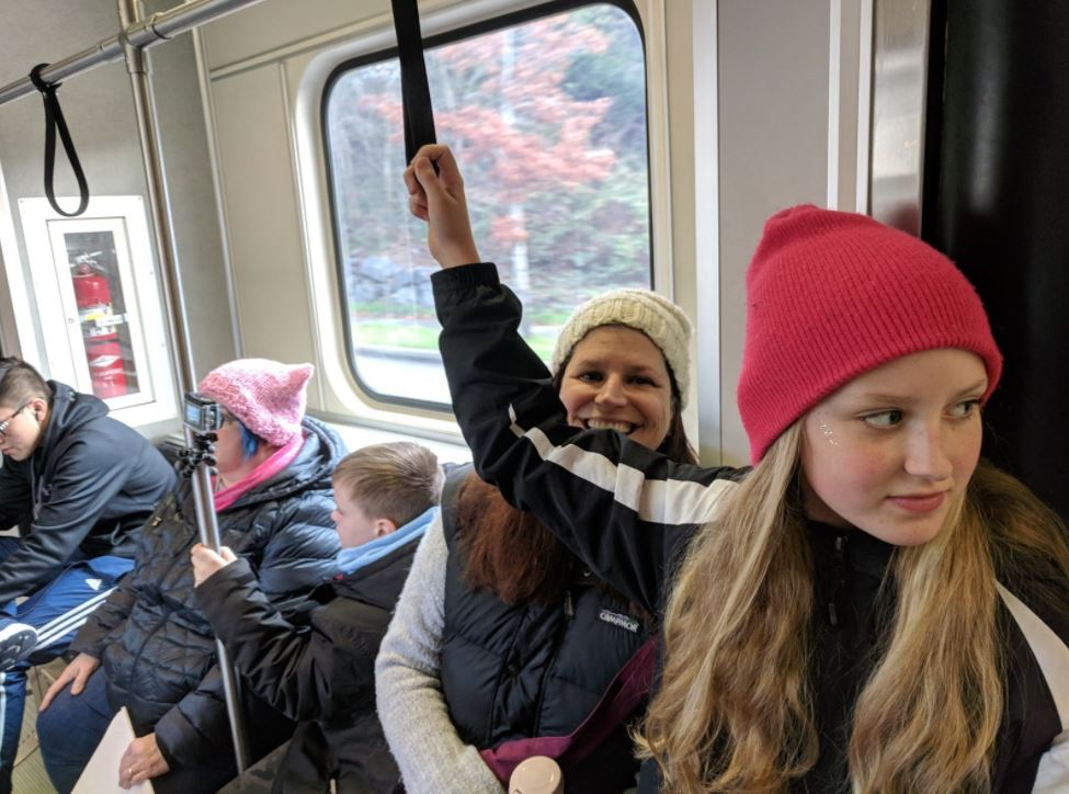 Women on their way to the march via light rail. (Photo: Sound Transit)