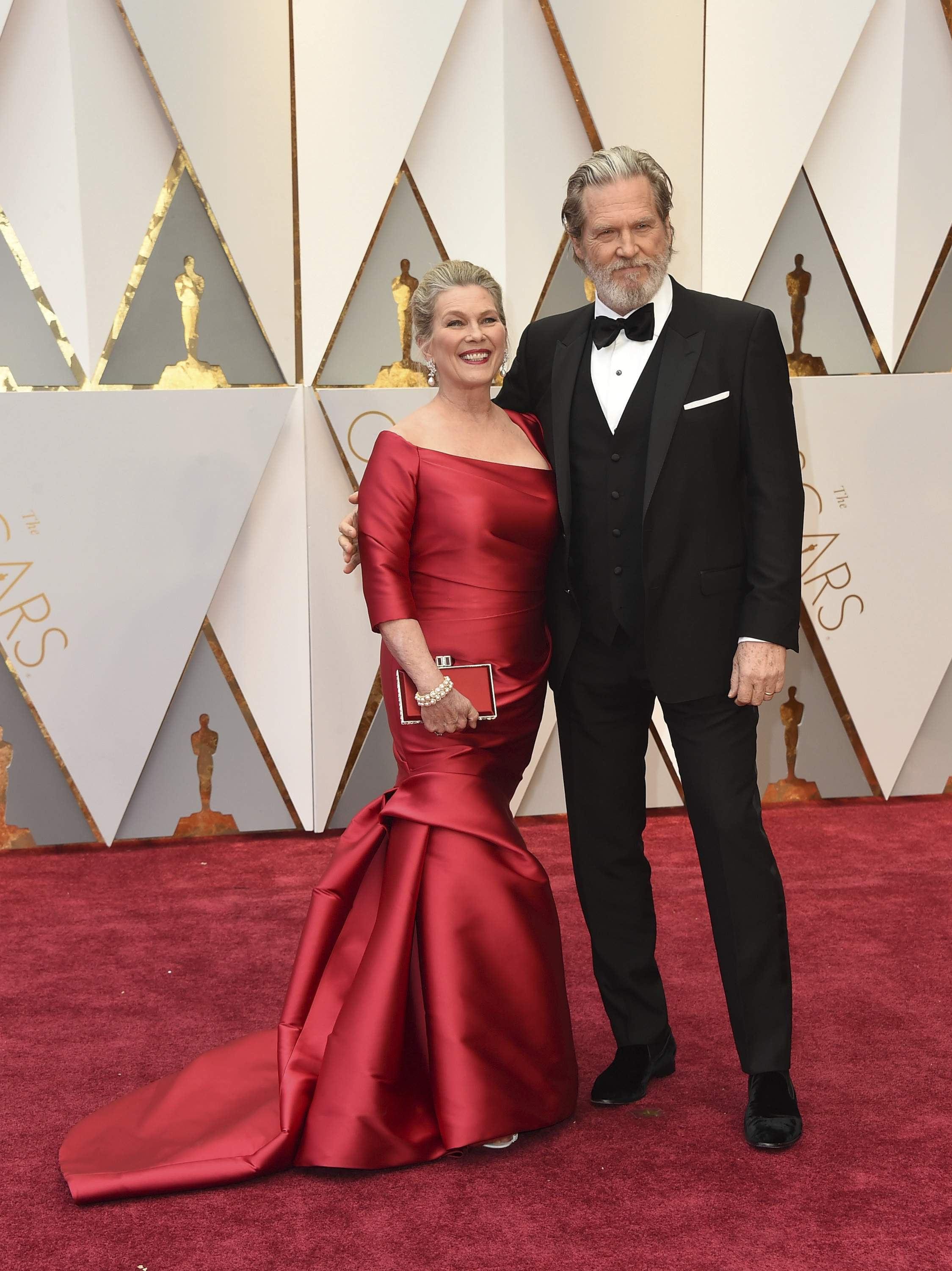 Susan Geston, left, and Jeff Bridges arrive at the Oscars on Sunday, Feb. 26, 2017, at the Dolby Theatre in Los Angeles. THE ASSOCIATED PRESS