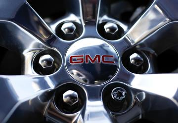 Without accounting loss, GM posts record full-year profits