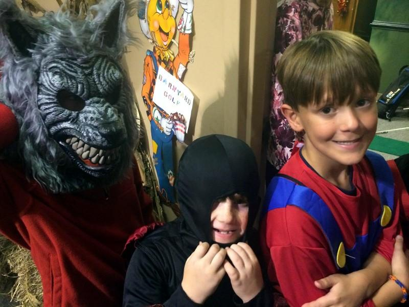 A werewolf, a ninja and Super Mario hanging out on Halloween.