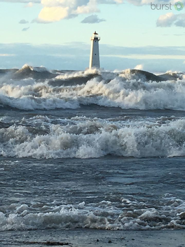 Large waves pound the shore of Sodus Point on Saturday.