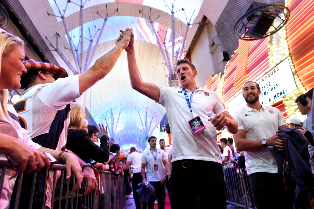 "Rugby players receive high fives from fans during the USA Sevens rugby ""Parade of Nations"" Thursday, March 3, 2017, at the Fremont Street Experience. CREDIT: Sam Morris/Las Vegas News Bureau"