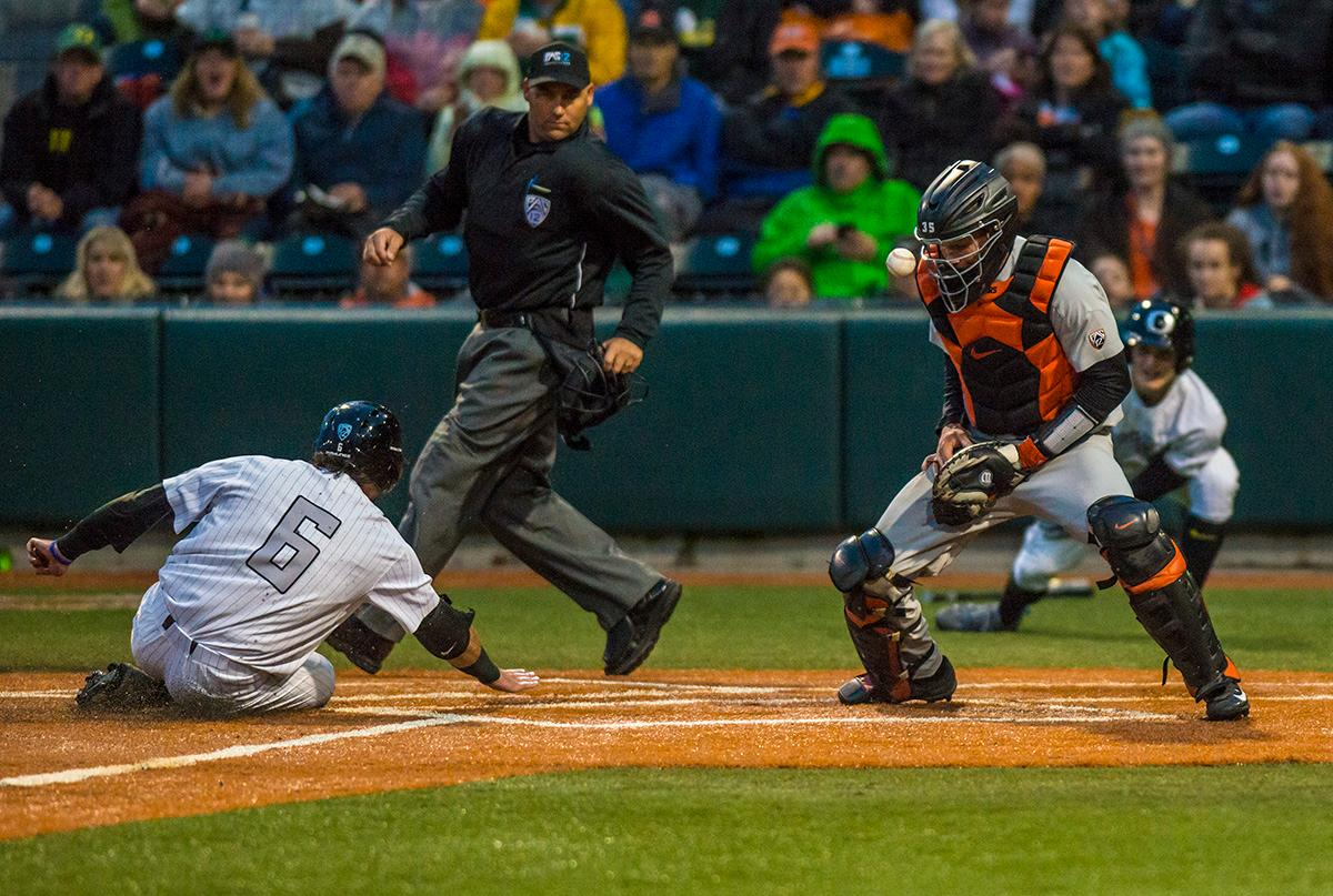 Oregon Ducks Tim Susanna (#6) slides into home base as Oregon State Beavers catcher loses control of the ball and misses the out. The Oregon State Beavers defeated the Oregon Ducks 5-4 in game two of the Civil War three-game series on Friday night at PK Park. This loss is the fifth straight loss for the Ducks, in which four have been by a single run. The final game of the Civil War series will be on Saturday, May 13th at 7pm. Photo by Rhianna Gelhart, Oregon News Lab