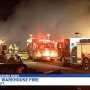 Multiple crews battle warehouse fire in Schoolcraft