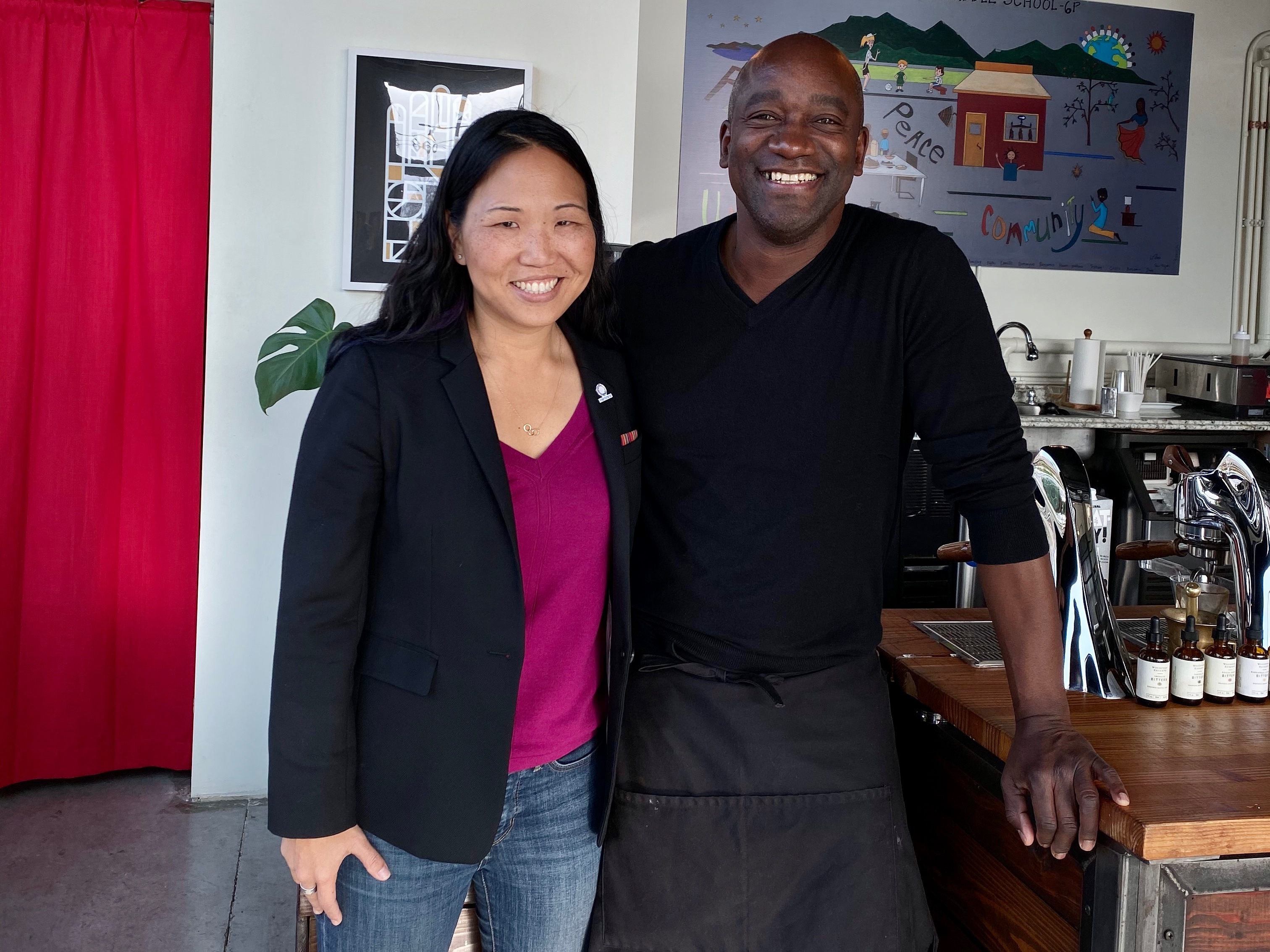 A pre-pandemic snap of Intentionalist CEO, Laura Clise, with Brian Wells, owner of Tougo Coffee, a multi-roaster coffee shop on Yesler. Small businesses like Tougo Coffee are places where we connect with familiar faces and make new connections, one cup of coffee at a time. (Image: Intentionalist)