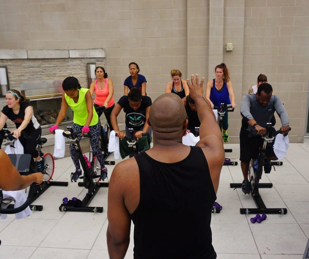 Saturday:{ }In celebration of spring, Silver Spring fitness studio CYCLED! is taking things outdoors, with their popular LIVE DJ Rooftop Rides series. (Image: Courtesy CYCLED!)