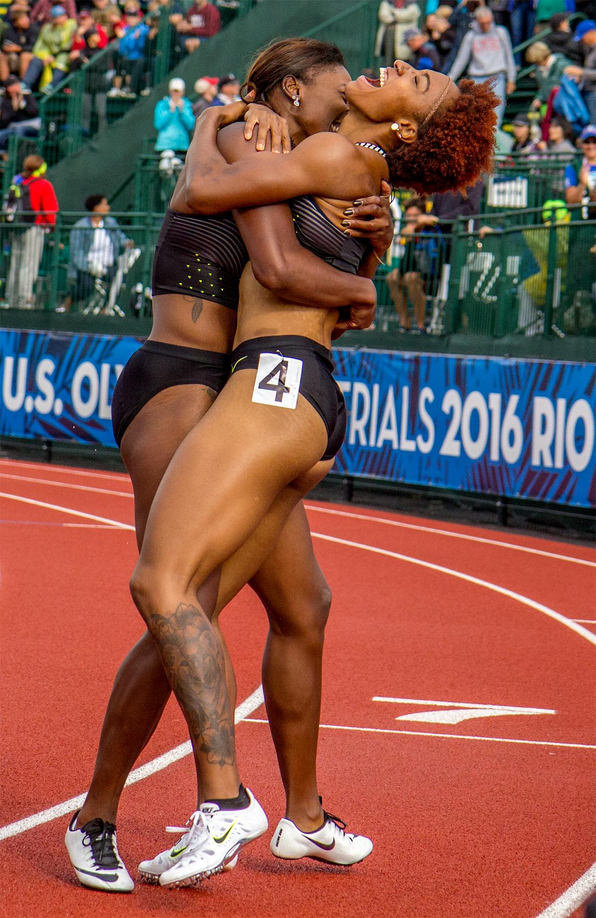 Nike's Brianna Rollins (right) and Nia Ali (left) celebrate their first and third place in the 100 meter hurdles. Rollins won with a time of 12.34 and Ali finished third with a time of 12.55. Photo by August Frank, Oregon News Lab