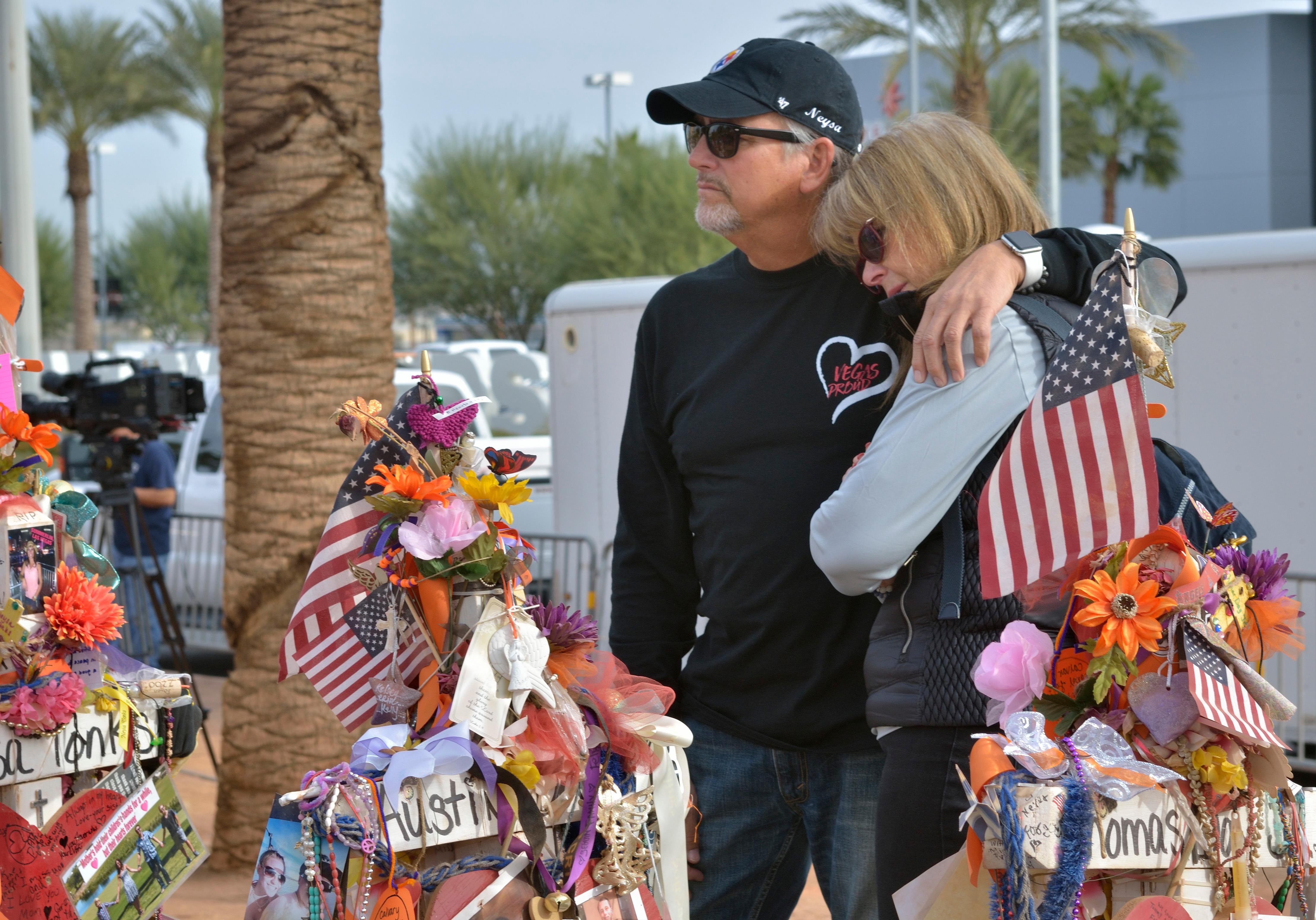 "Chris and Debbie Davis are shown near a memorial cross for their daughter Neysa Tonks during ""Greg Zanis Day"" at the Welcome to Fabulous Las Vegas sign on the Las Vegas Strip on Sunday, Nov. 12, 2017. Zanis, a carpenter from Aurora, Ill., was recognized by the Clark County Commision for creating 58 crosses memorializing those who died during the Route 91 Harvest festival shooting on Oct. 1. The crosses were later moved to the Clark County Museum for its permanent collection. [Bill Hughes/Las Vegas News Bureau]"
