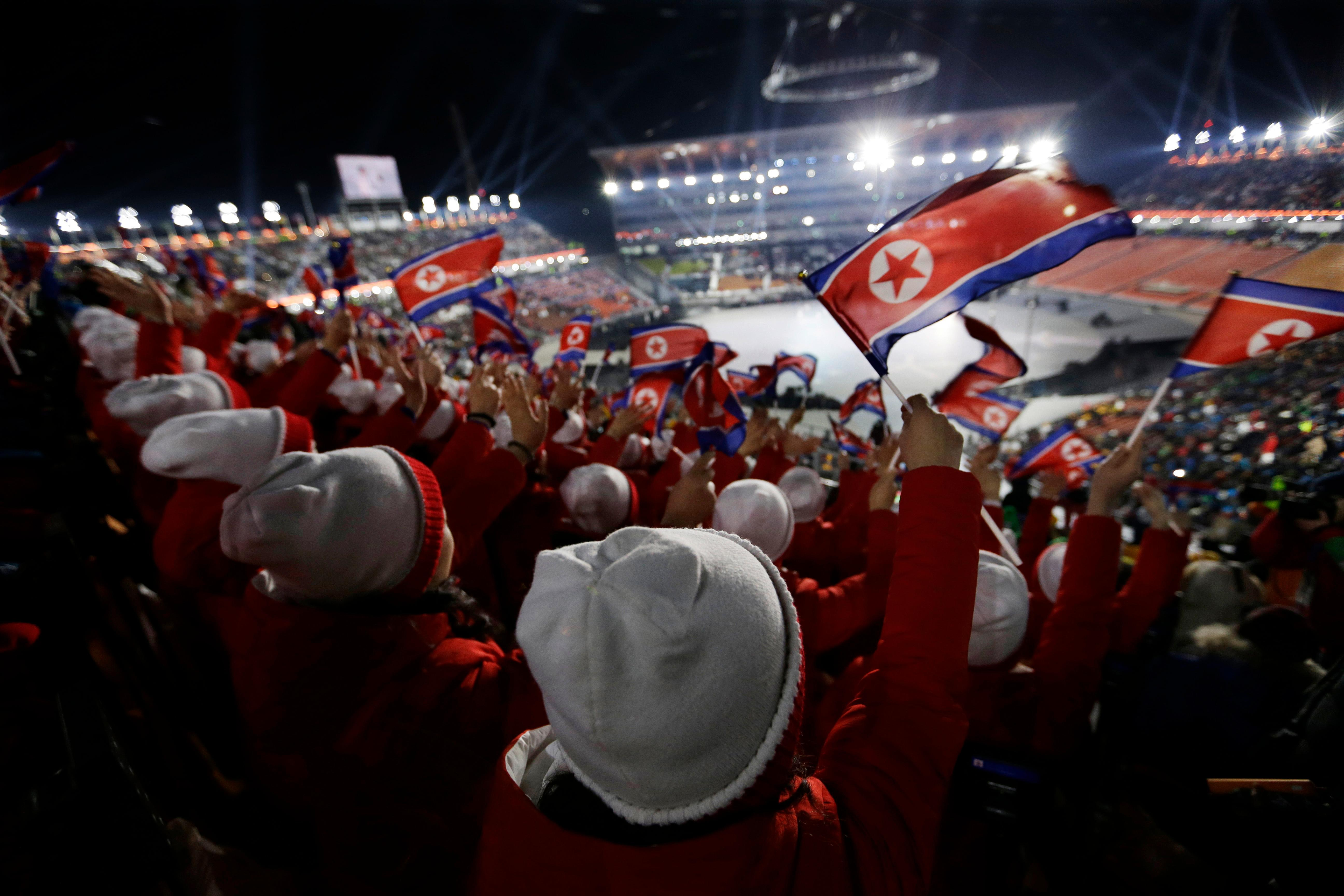 Members of the North Korean delegation wave flags before the opening ceremony of the 2018 Winter Olympics in Pyeongchang, South Korea, Friday, Feb. 9, 2018. (AP Photo/Natacha Pisarenko)
