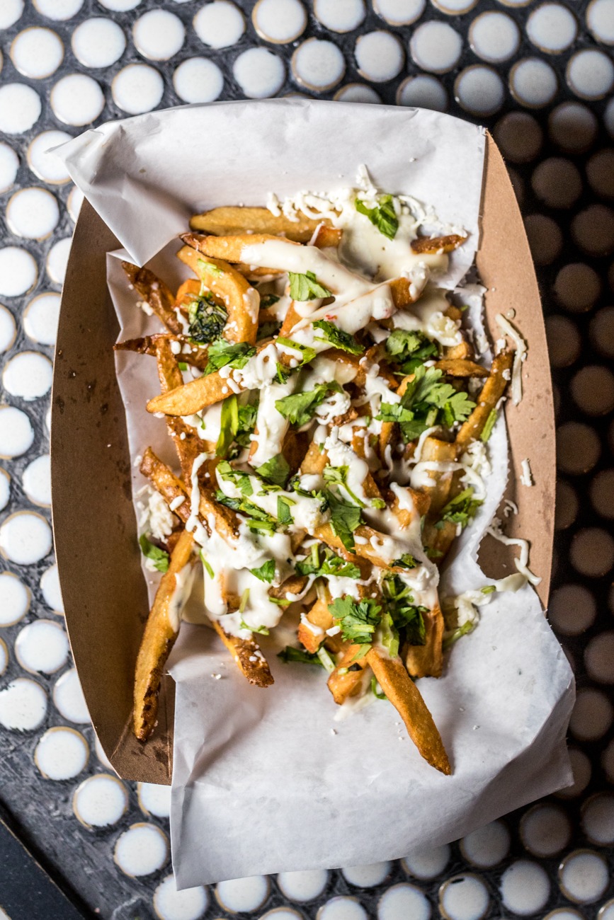 Queso Fritas: salt and pepper french fries, cotija, oaxaca cheese, queso, and cilantro / Image: Catherine Viox // Published: 8.24.20