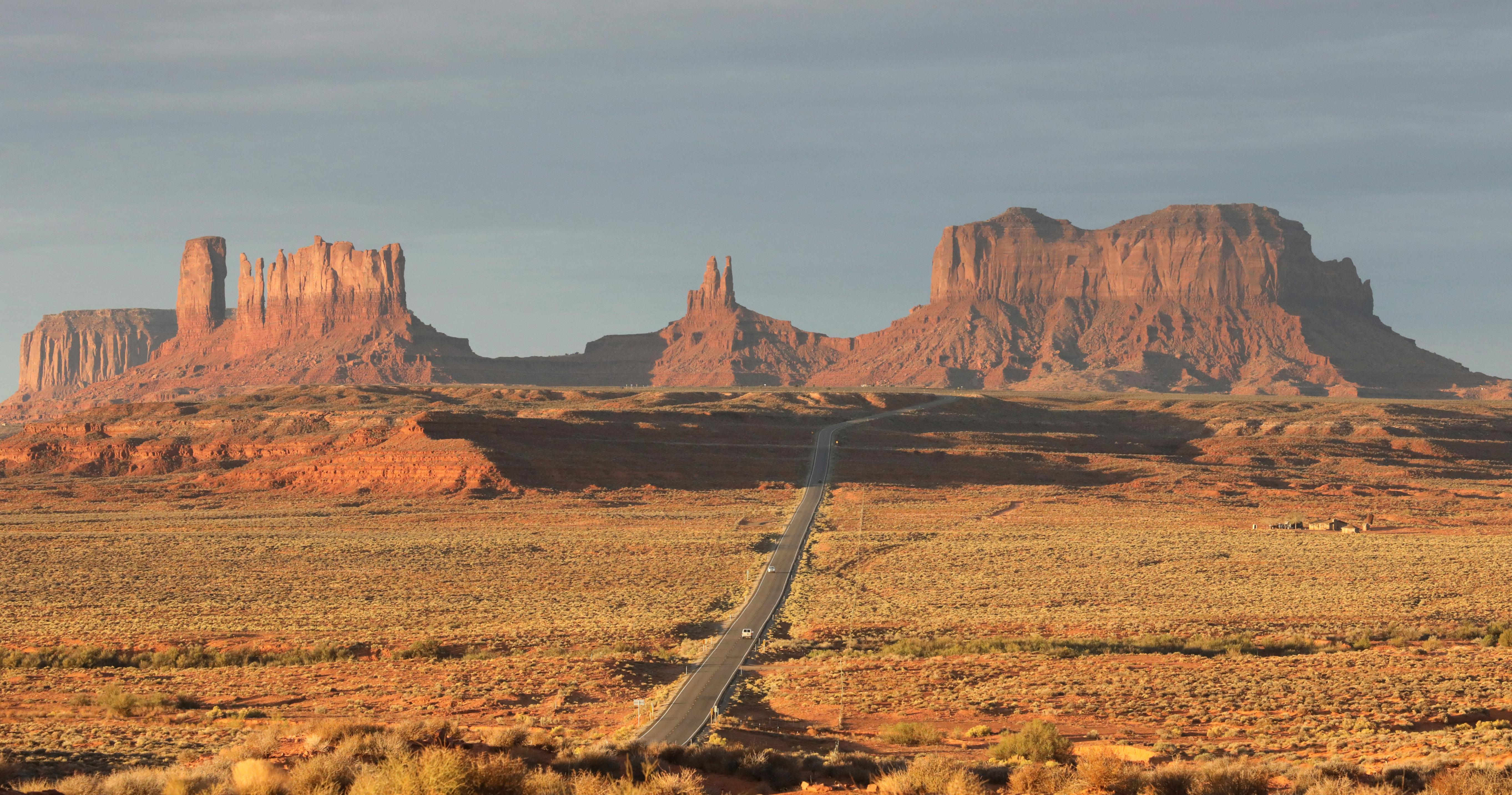 FILE - This Oct. 25, 2018 file photo shows Monument Valley, Utah. In the U.S. Southwest, the leader of the Navajo Nation restricted travel for employees who answer to him and wrote letters to federal officials saying anyone pulled away from duty at federal health care facilities on the vast reservation wouldn't be welcome back for 45 days. Tribes across the country have closed casinos to help slow the spread of the new coronavirus. In the U.S. Southwest, the leader of the Navajo Nation restricted travel for employees who answer to him and wrote letters to federal officials saying anyone pulled away from duty at federal health care facilities on the vast reservation wouldn't be welcome back for 45 days. (AP Photo/Rick Bowmer, File)