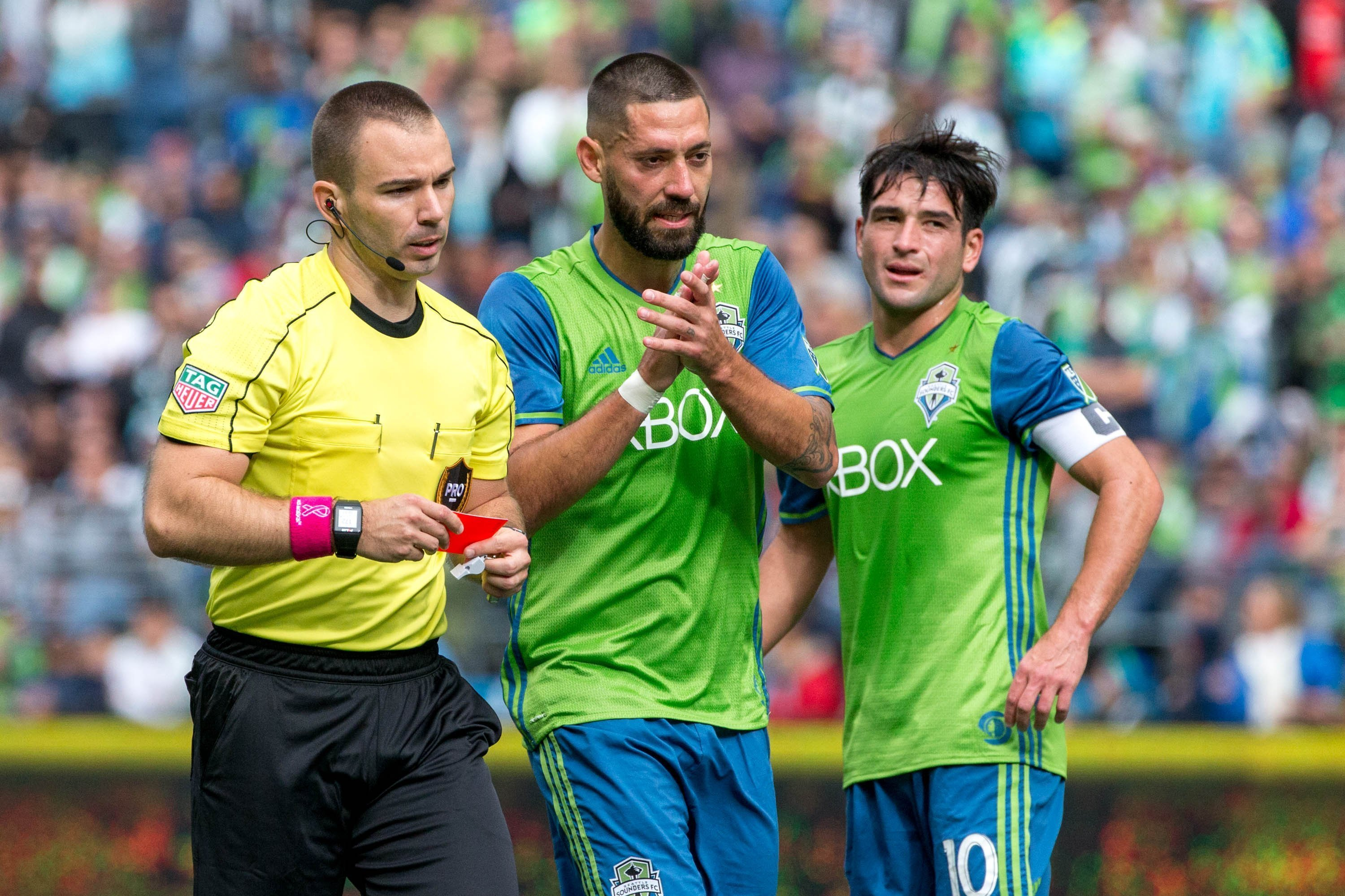 Seattle Sounders midfielder Clint Dempsey (2) walks back with the referee after receiving a red card during the first half of an MLS soccer game against the Colorado Rapids in Seattle on Sunday, Oct. 22, 2017. (Courtney Pedroza/The Seattle Times via AP)