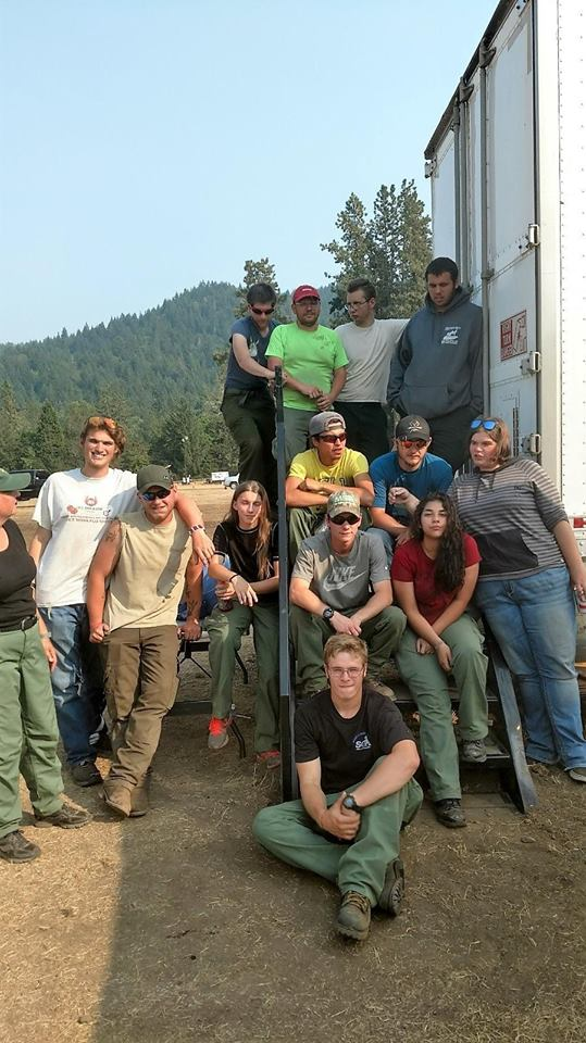 Members of the Wolf Creek Job Corps Civilian Conservation Center take a break from providing lunches, water and logistical support to the firefighting efforts of the Umpqua North Complex. Job Corps Centers around the country provide education, job training and life skills to youth ages 16-24. (Photo courtesy US Forest Service-Umpqua National Forest)