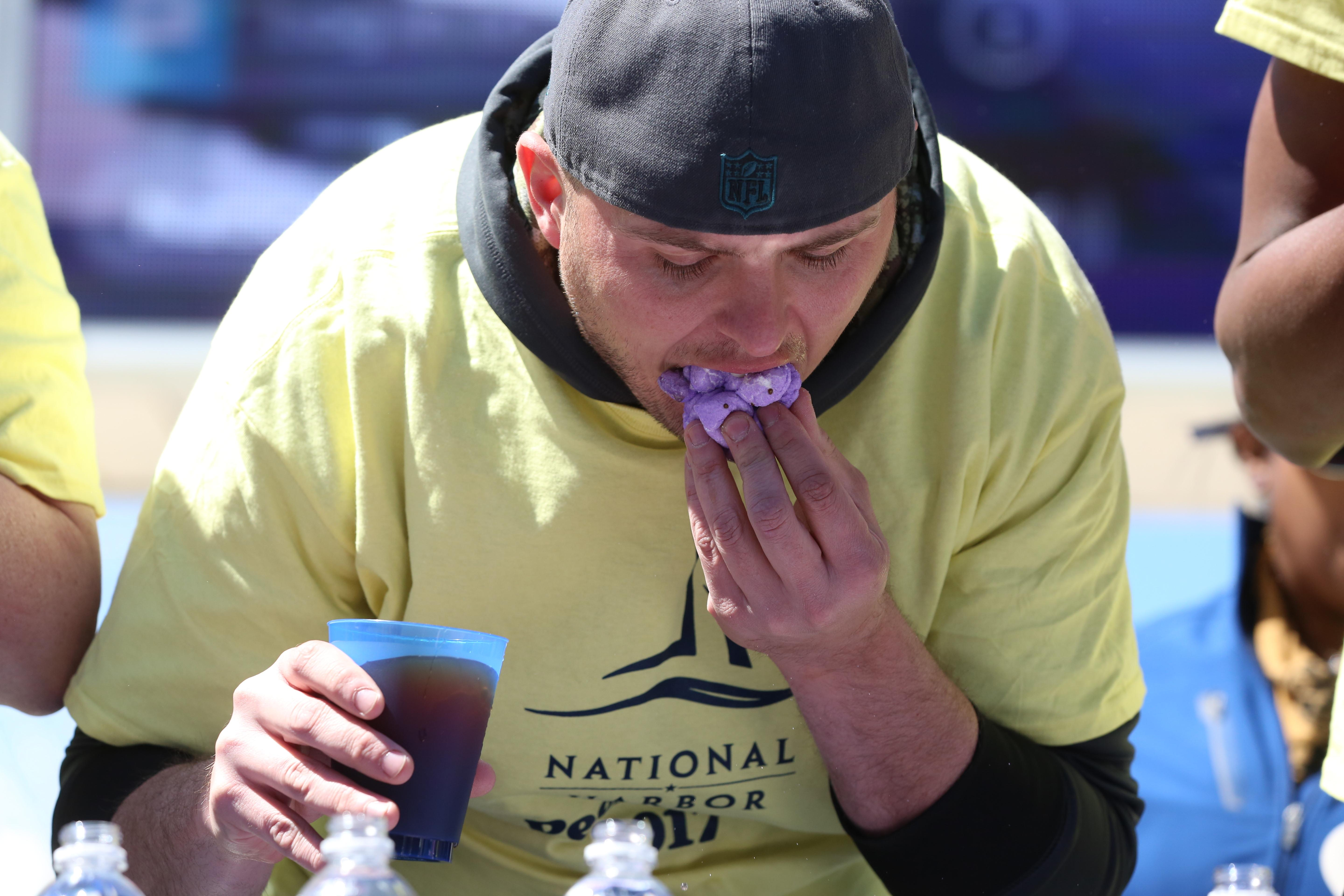 Competitive eating is a well-known American pastime, but there's something about watching grown adults stuff their mouths with multi-colored Easter candy in the hopes of winning money. On April 9, a panel of professional competitive eaters ate as many Peeps as possible over the course of 5 minutes for National Harbor's annual Peeps Day. (Amanda Andrade-Rhoades/DC Refined)