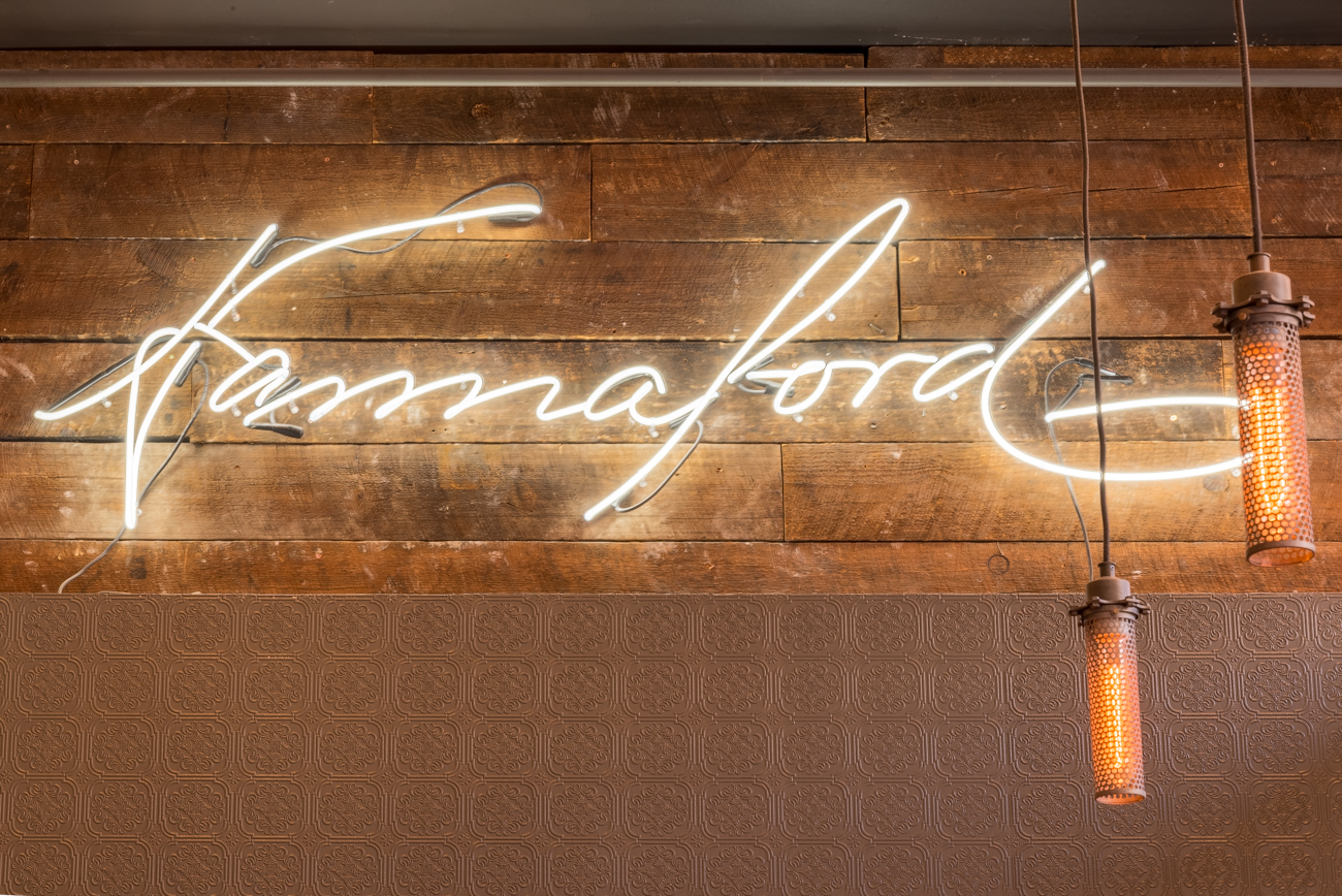 A neon sign in the shape of Hannaford's actual signature illuminates the wall opposite the front door for maximum aesthetic effect. / Image: Phil Armstrong, Cincinnati Refined // Published: 12.30.16