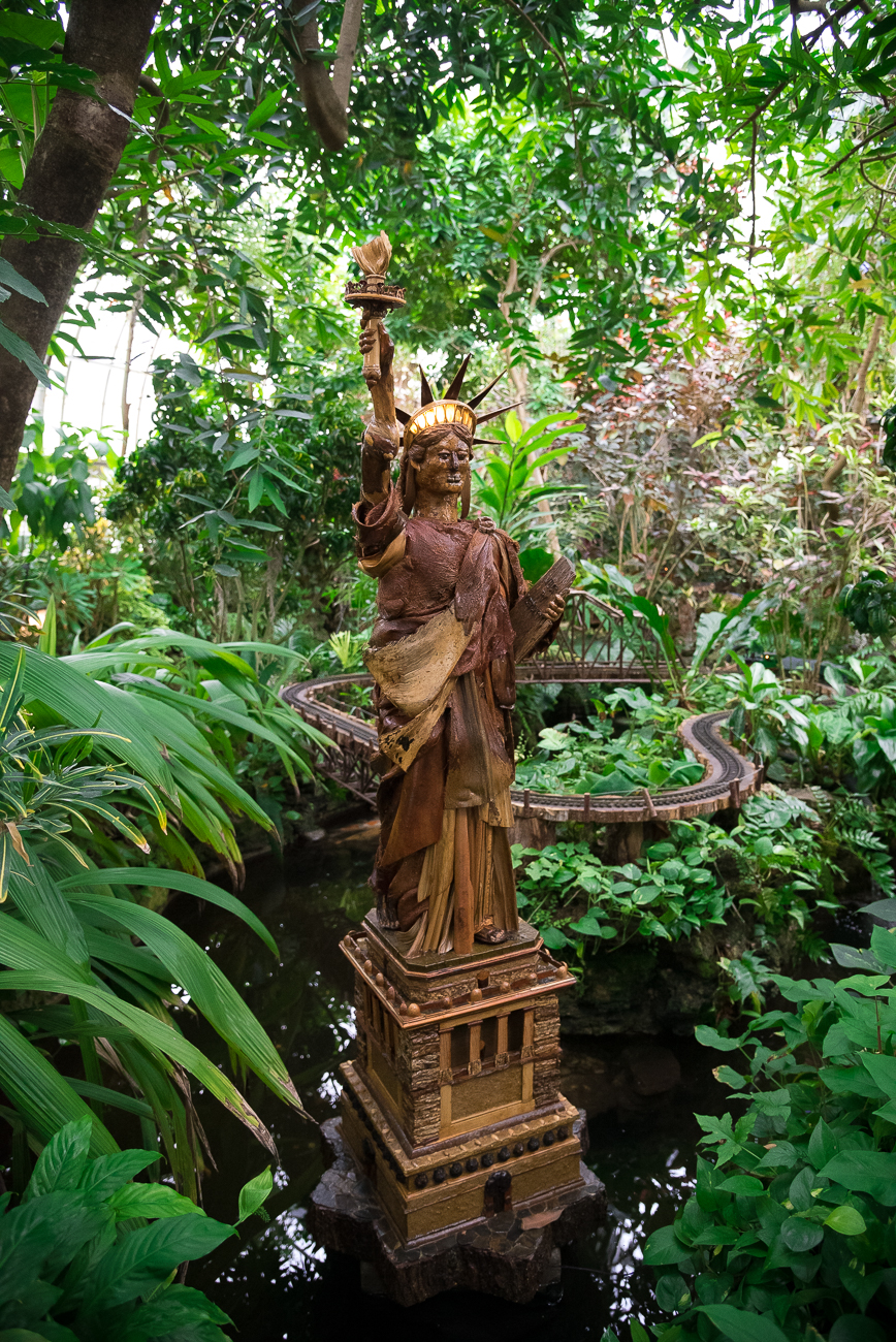 The Statue of Liberty made the jump from Liberty Island to this spot inside the left wing of the conservatory.{ }/ Image: Phil Armstrong, Cincinnati Refined // Published: 12.18.18