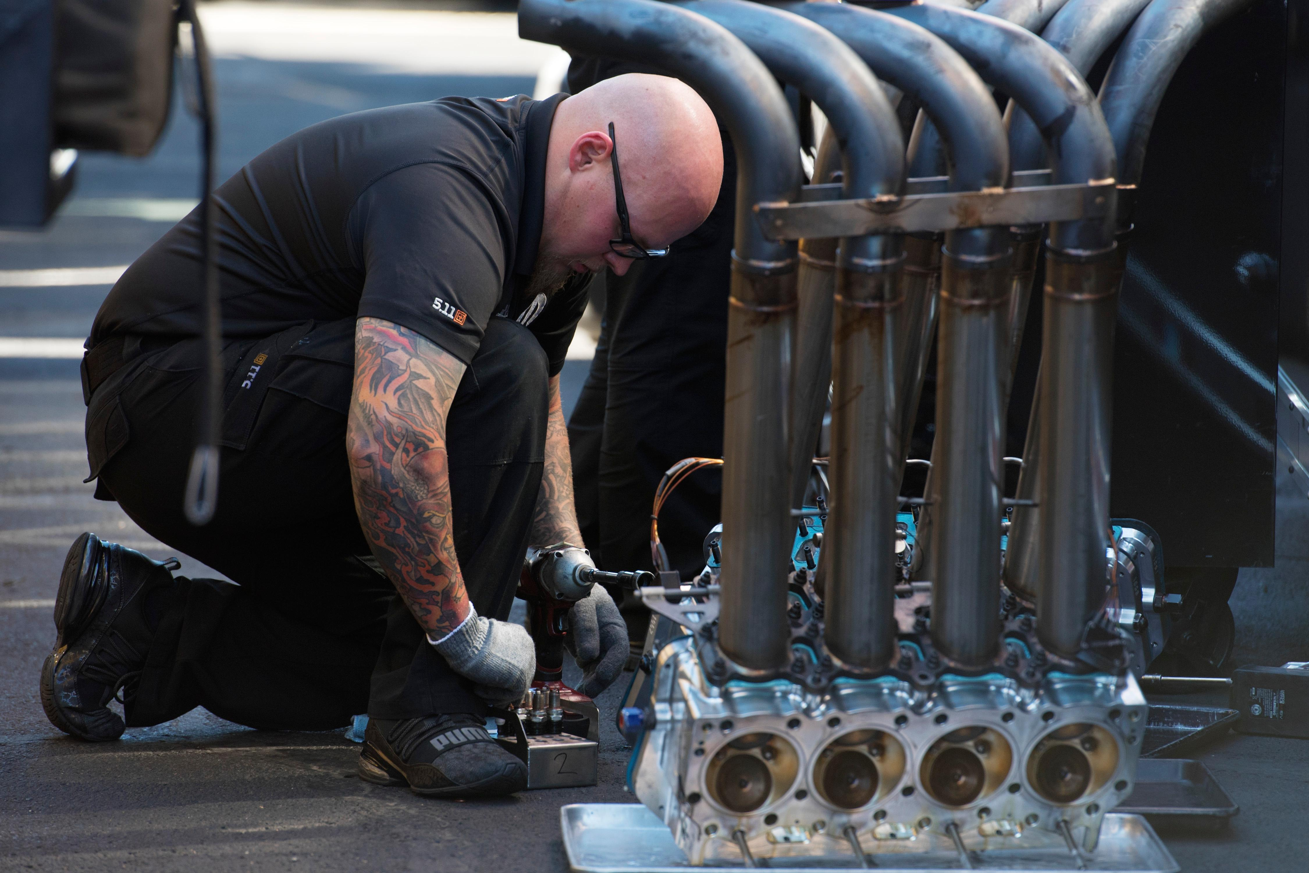 One of Matt Hagen's crew members works on their engine during the NHRA Toyota Nationals Sunday, October 29, 2017, at The Strip at the Las Vegas Motor Speedway. CREDIT: Sam Morris/Las Vegas News Bureau