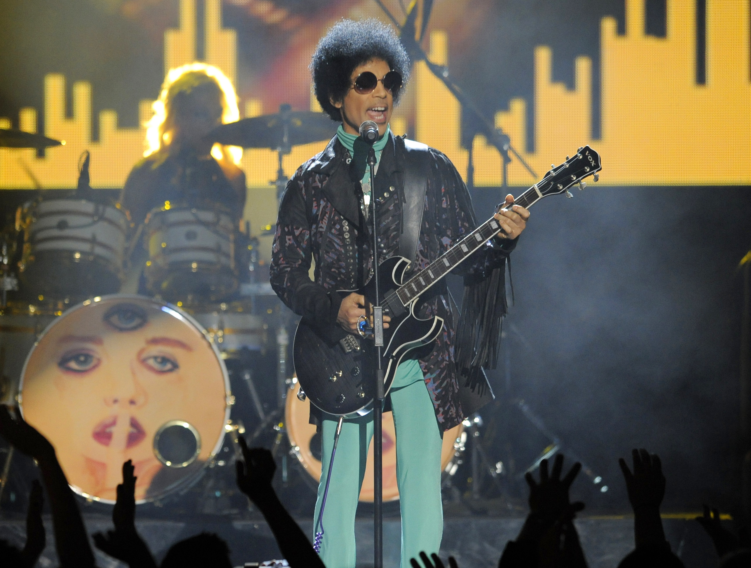 FILE - In this May 19, 2013 file photo, Prince performs at the Billboard Music Awards at the MGM Grand Garden Arena in Las Vegas. Drug overdose deaths in the U.S. skyrocketed 21 percent in 2016, dragging down life expectancy predictions for a second straight year, according to a report released by the Centers for Disease Control and Prevention on Thursday, Dec. 21, 2017. (Photo by Chris Pizzello/Invision/AP, File)