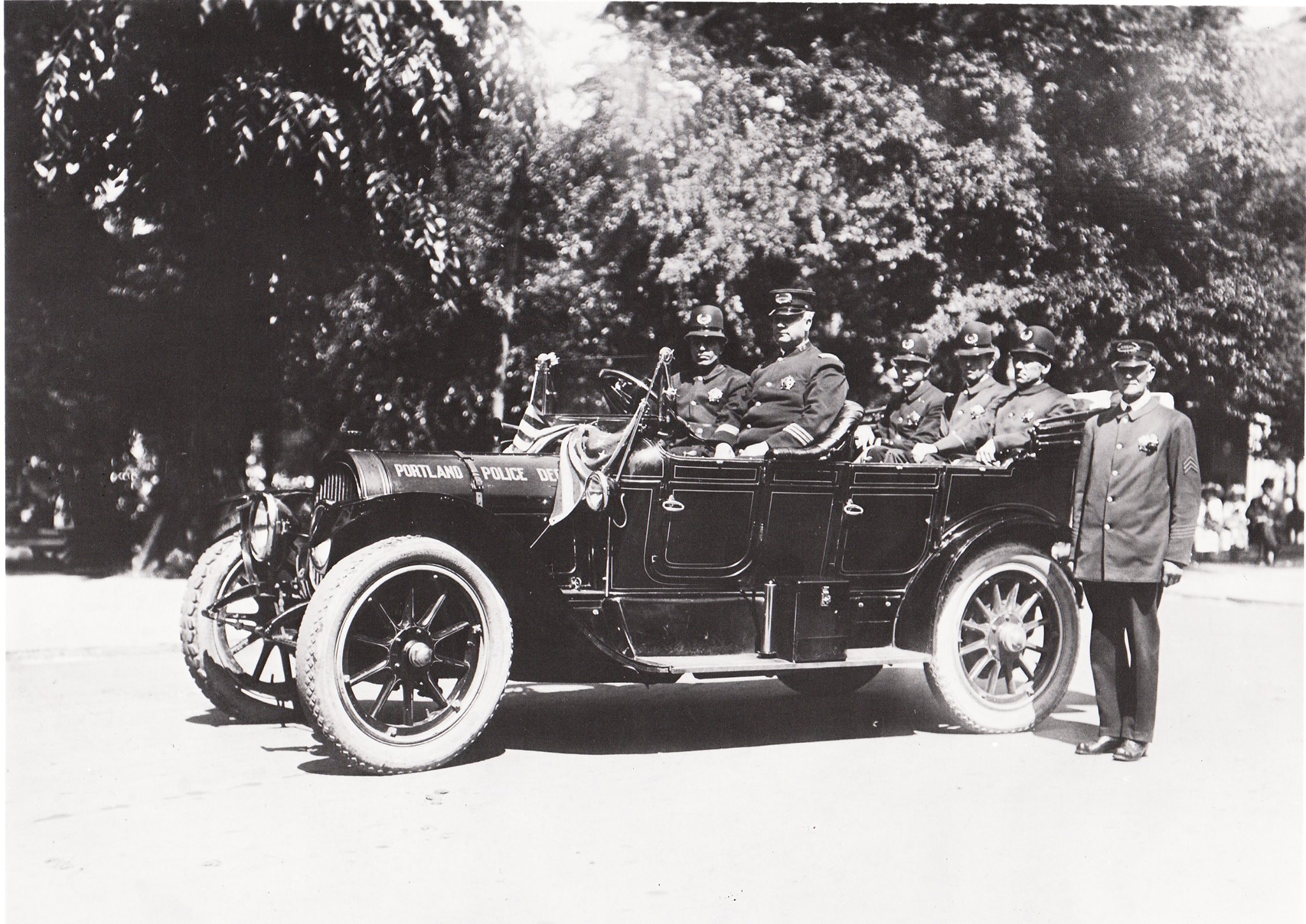 Portland Police officers in 1912 in the bureau's first police car (not a REO).(Portland Police Museum)<p></p>