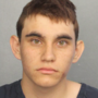 Troubled teen charged with 17 murders in school attack legally bought AR-15