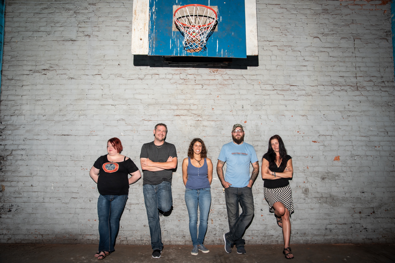 Sara Cole, Ryan Hill, Di Del Pilar Cendales, Matt Meyung, and Linnoir Rich are pictured in the abandoned Boys & Girls Club above the Artifact Gallery in Newport, KY. The members of this tight-knit group met after crossing paths around town at art fairs and markets, and as they bonded they also became inspired by one another, even collaborating from time to time.{ }You can see their works in the pop-up gallery at Vine Street's Brick OTR on the weekend of June 28-29 from 11 AM-11 PM, and June 30th from 11 AM-6 PM. / Image: Melissa Sliney // Published: 6.26.19{ }