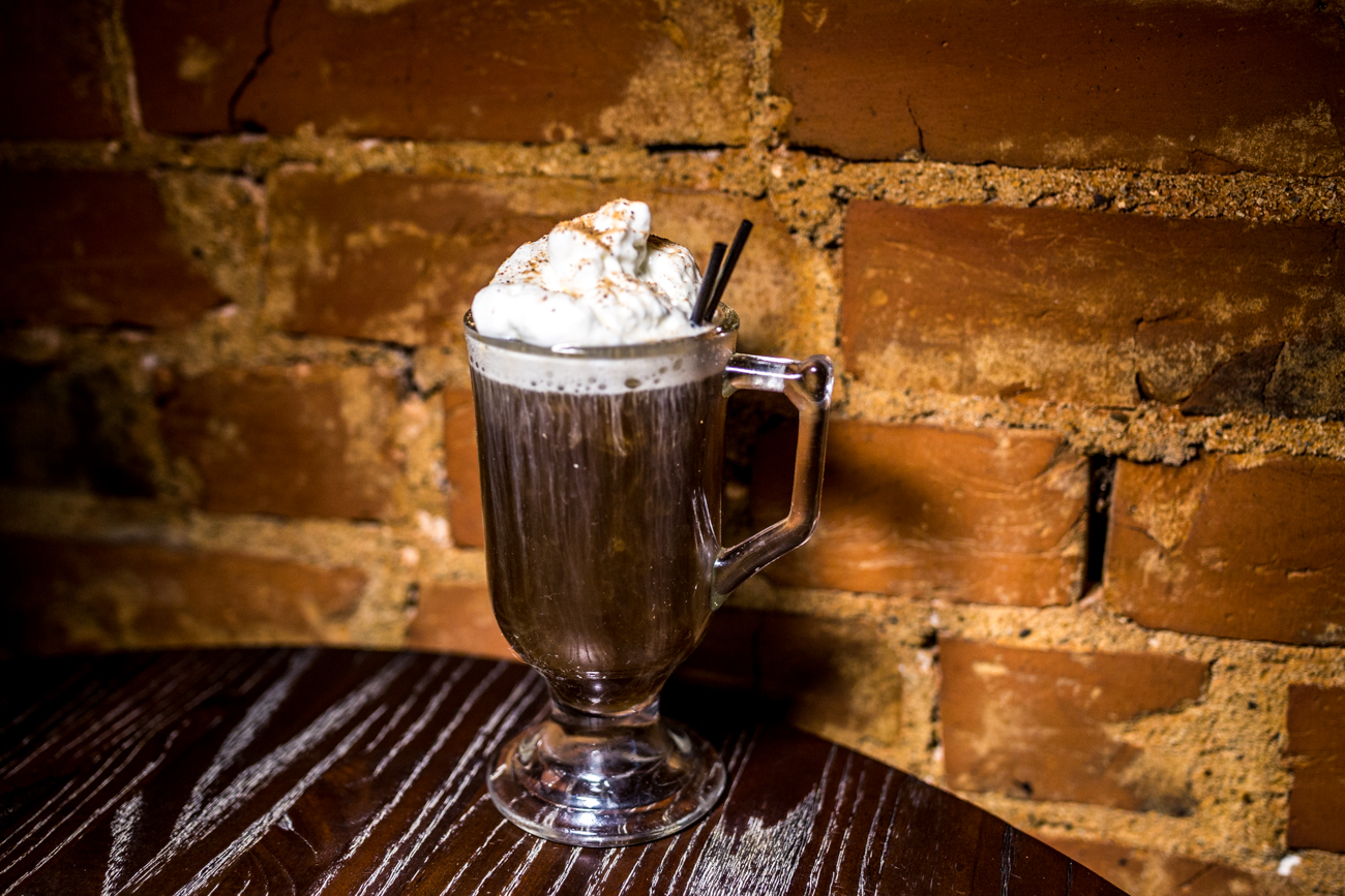 The Kentucky Coffee: house bourbon, coffee liquor, brown sugar reduction, and topped with whipped cream & cinnamon / Image: Catherine Viox{ }// Published: 7.30.19