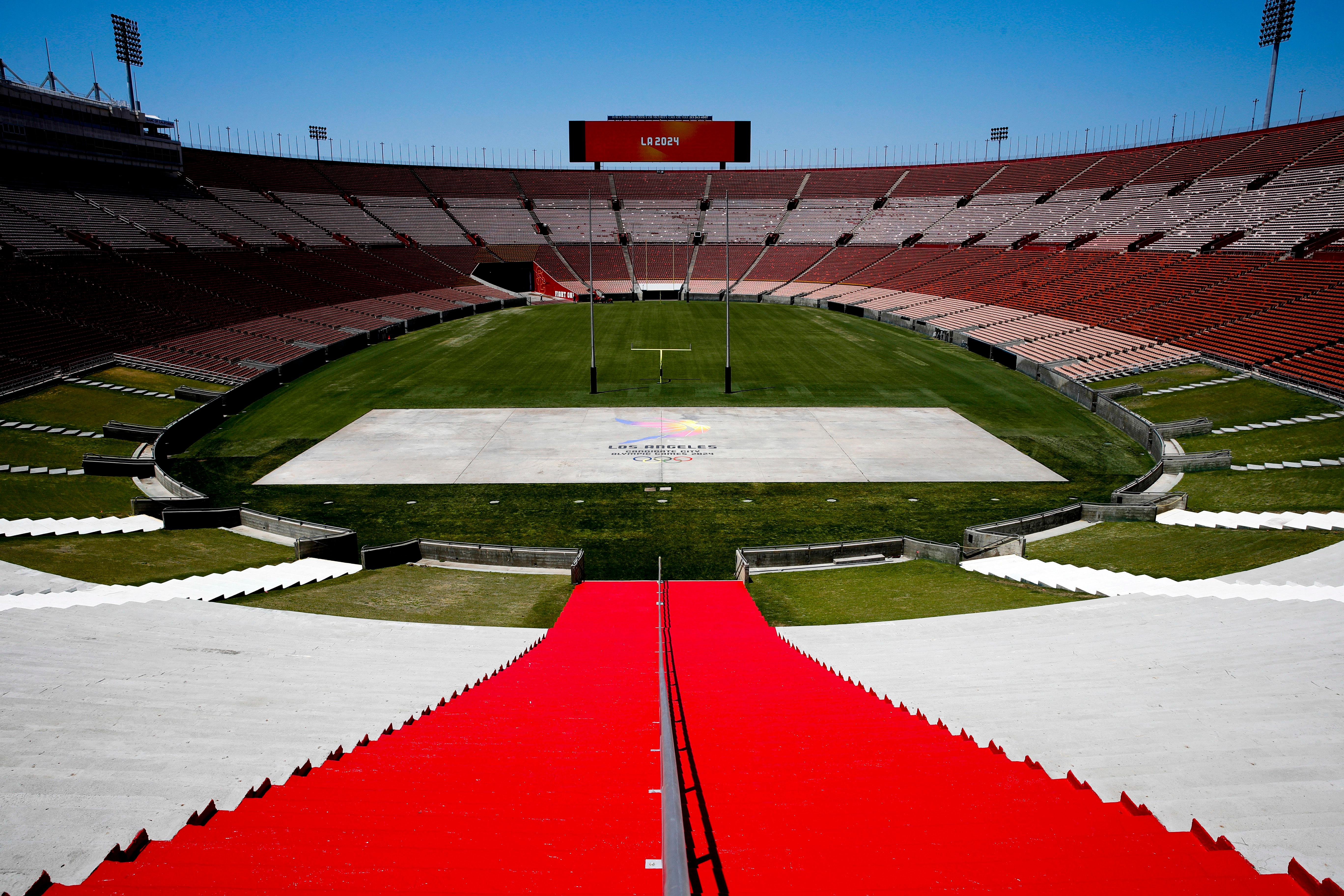 FILE - In this May 11, 2017, file photo, Los Angeles Memorial Coliseum, the venue proposed for Olympic opening and closing ceremonies and track and field events, stands in Los Angeles. (AP Photo/Jae C. Hong, File)