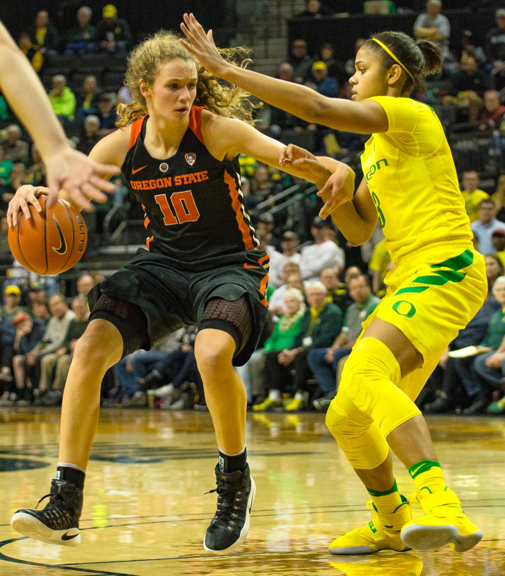 Oregon Ducks Guard Justine Hall (#3) denies Oregon State Guard Katie Mcwilliams (#10) as she drives to the lane. Oregon Ducks lost 40-43 to Oregon State Beavers in a tightly matched fourth quarter. Photo by Jonathan Booker, Oregon News Lab