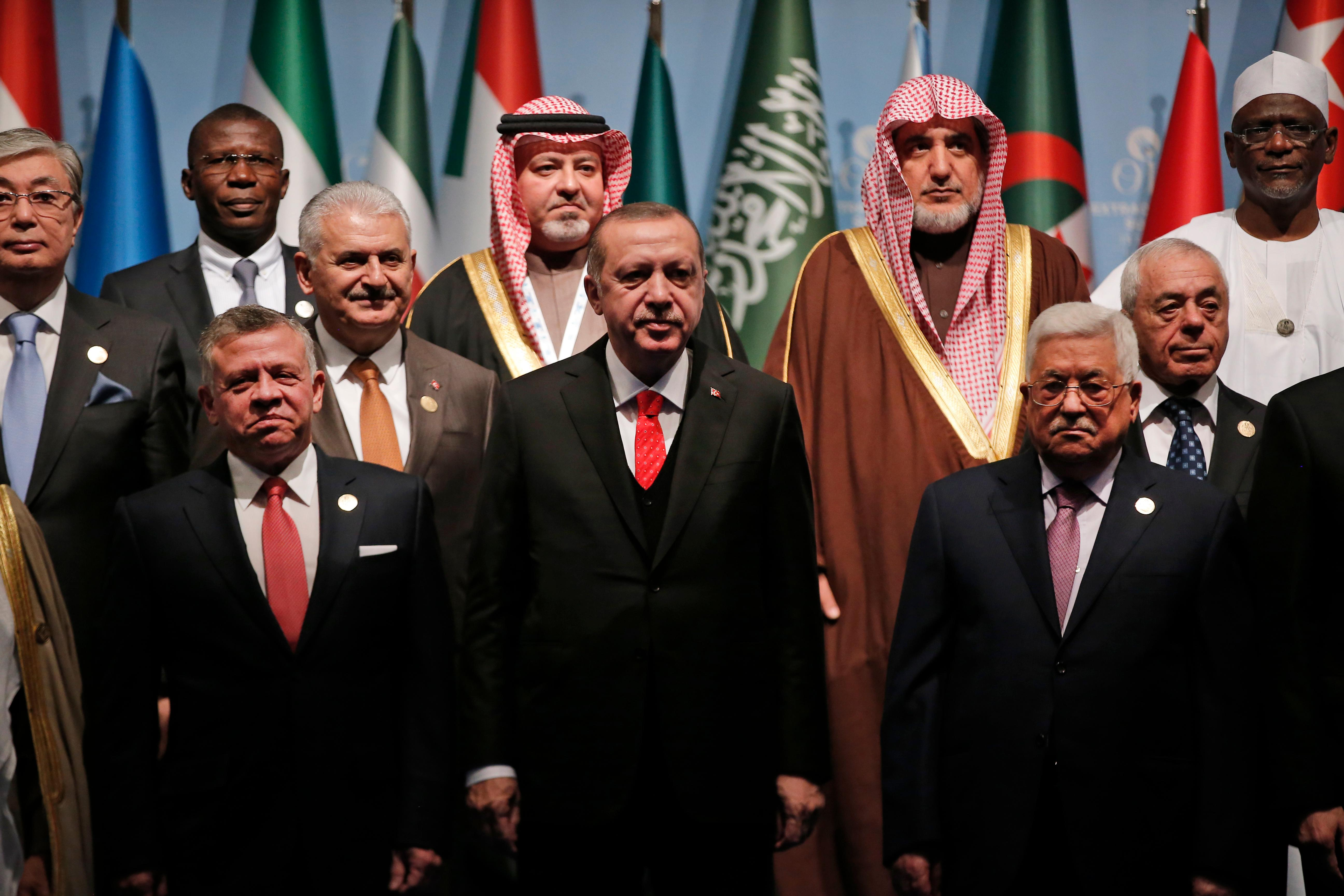 "Turkey's President Recep Tayyip Erdogan, centre, Funked by Jordan's King Abdullah II, left and Palestinian President Mahmoud Abbas, right, poses for photographs wth other leaders during a photo-op prior to the opening session of the Organisation of Islamic Cooperation in Istanbul, Wednesday, Dec. 13, 2017. Leaders and high-ranking officials of Muslim countries met in Istanbul to discuss the U.S. recognition of Jerusalem as Israel's capital. Erdogan_ term president of OIC, the umbrella organisation of 57-members, has been vehemently critical of the U.S. move and said the leaders would relay a ""strong message."" (AP Photo/Lefteris Pitarakis)"