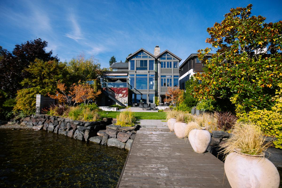 Selling at just under $6 million by Windermere, this Leschi home sits on the shores of Lake Washington, and boasts amenities like a perforated steel staircase, chef's kitchen, boat house, wine cellar, theater and art studio. (Image: Joshua Lewis / Seattle Refined)