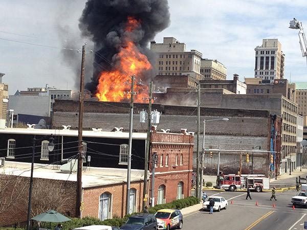 Smoke and flames engulf a large building in downtown Birmingham on Friday, March 29, 2013.