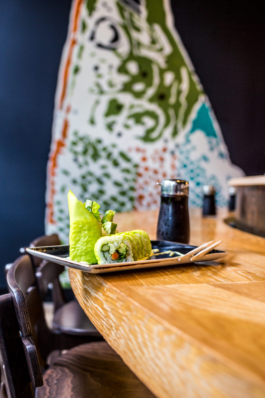 Green Roll (8 piece): soy paper, avocado, bibb lettuce, roasted asparagus, cucumber, radish sprout, Gobo root, and wasabi aioli with house-made soy sauce in the back / Image: Catherine Viox // Published: 9.9.19