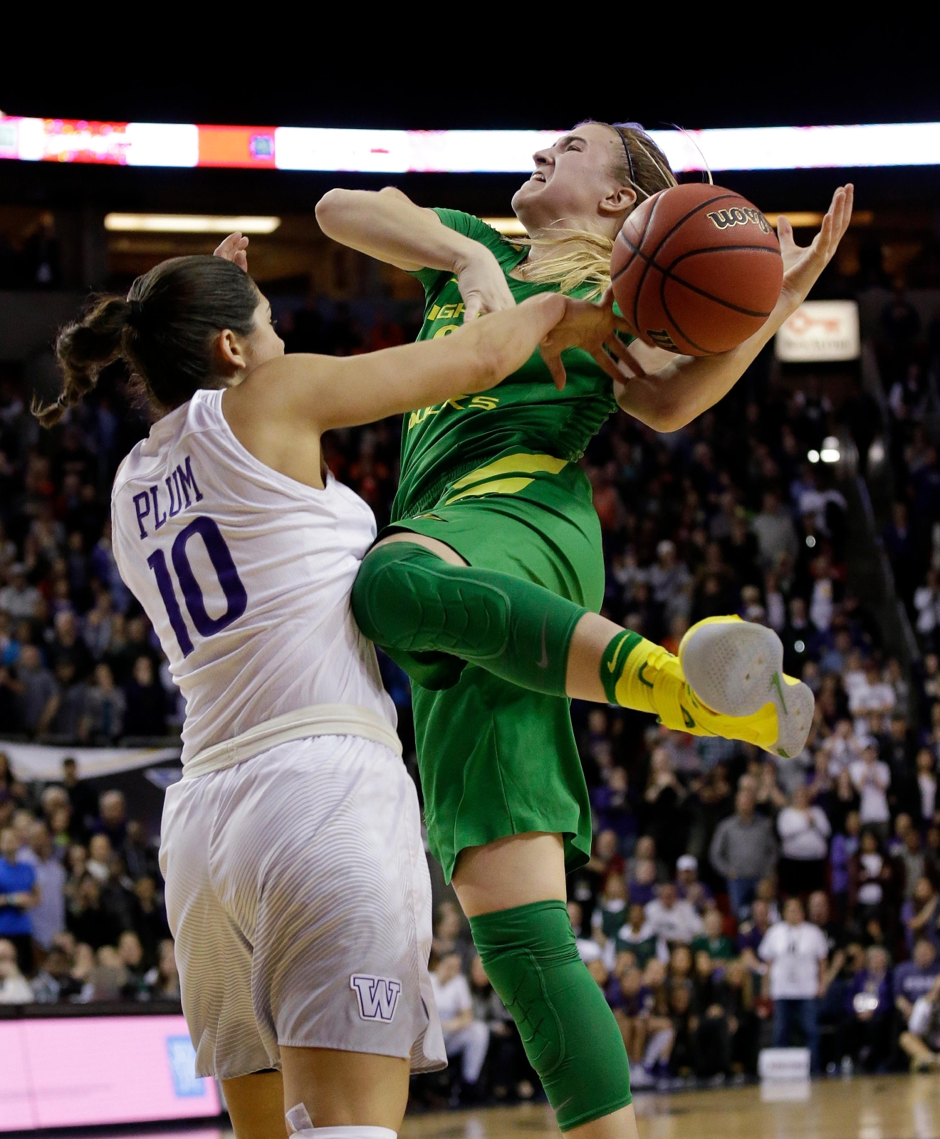 Washington's Kelsey Plum (10) fouls Oregon's Sabrina Ionescu late in the second half of an NCAA college basketball game in the Pac-12 tournament, Friday, March 3, 2017, in Seattle. Oregon won 70-69. (AP Photo/Elaine Thompson)